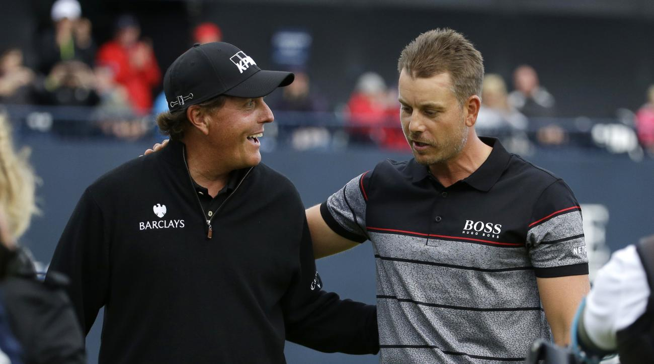 FILE - In this July 17, 2016, file photo, Phil Mickelson, of the United States, left, congratulates Henrik Stenson, of Sweden, for winning the British Open Golf Championships at the Royal Troon Golf Club in Troon, Scotland. Erin Hills is the longest U.S.