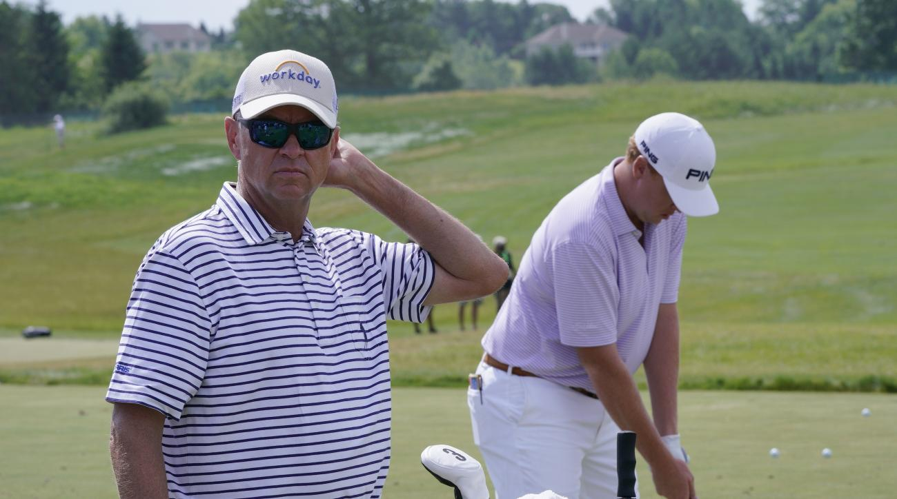Davis Love III watches his son Davis Love IV hit on the range during a practice day for the U.S. Open golf tournament Wednesday, June 14, 2017, at Erin Hills in Erin, Wis. (AP Photo/Morry Gash)