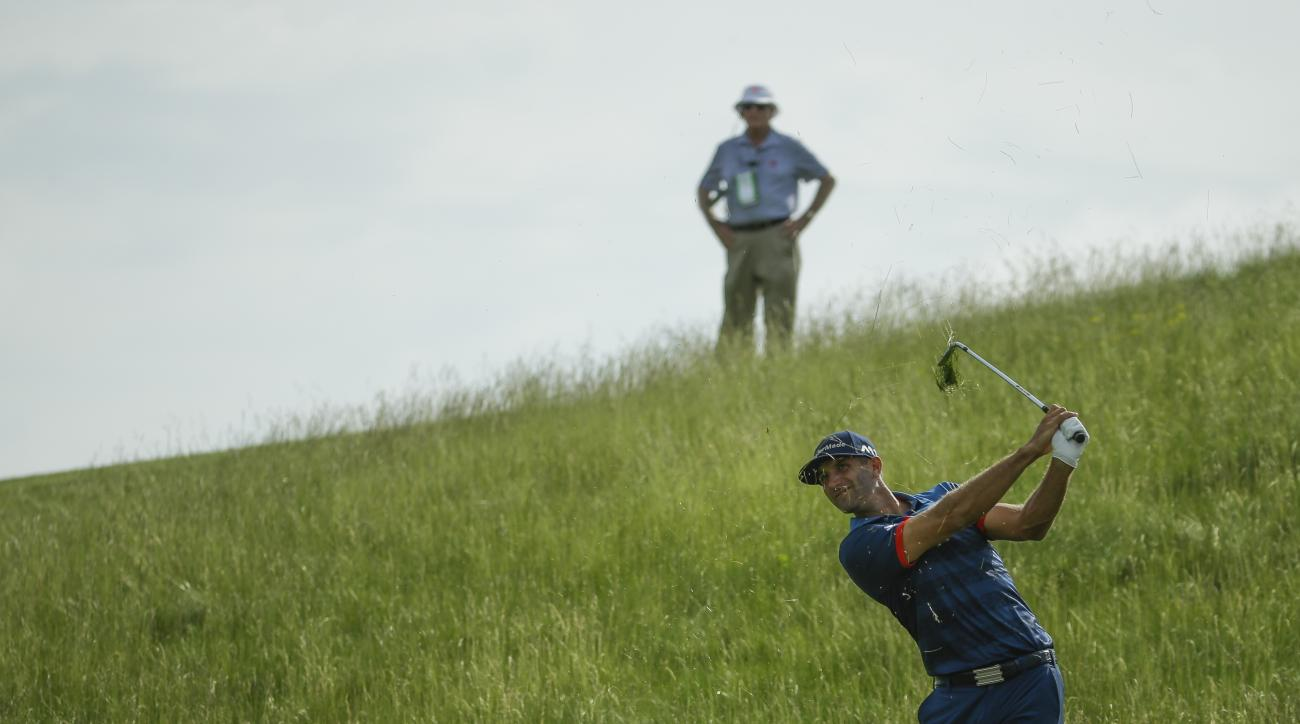 Dustin Johnson hits from the fescue on the 12th hole during the first round of the U.S. Open golf tournament Thursday, June 15, 2017, at Erin Hills in Erin, Wis. (AP Photo/Chris Carlson)