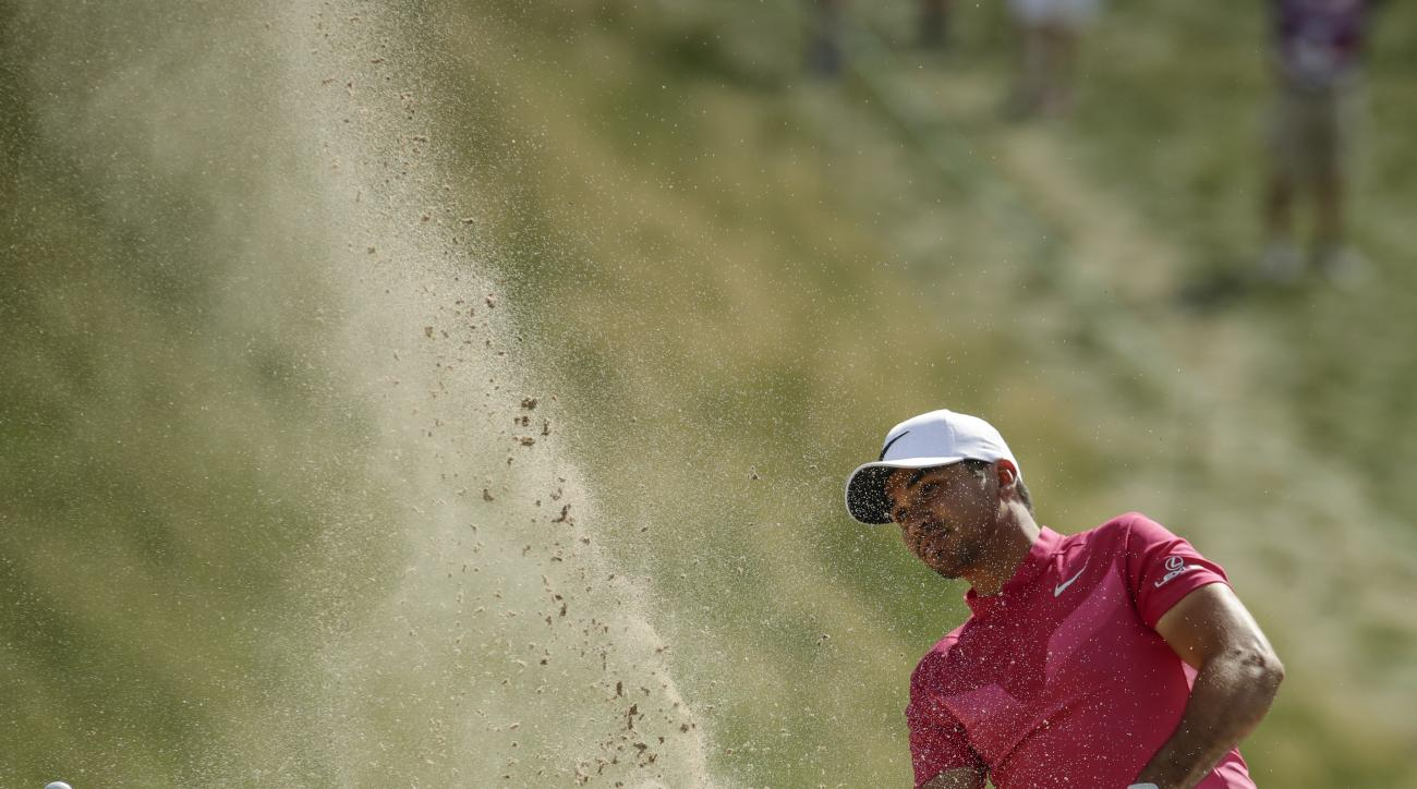 Jason Day, of Australia, hits from a bunker on the eighth hole during the first round of the U.S. Open golf tournament Thursday, June 15, 2017, at Erin Hills in Erin, Wis. (AP Photo/Charlie Riedel)