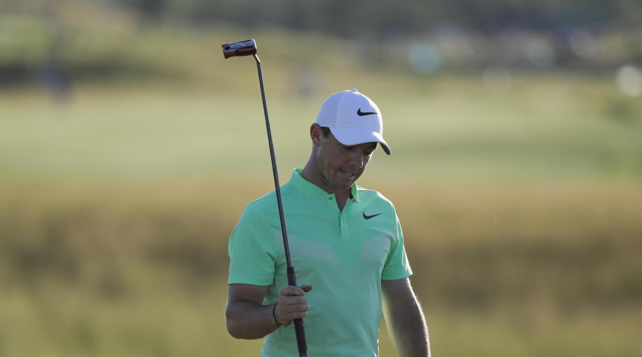 Rory Mcilroy, of Ireland, reacts after putting on the 18th hole during the first round of the U.S. Open golf tournament Thursday, June 15, 2017, at Erin Hills in Erin, Wis. (AP Photo/David J. Phillip)