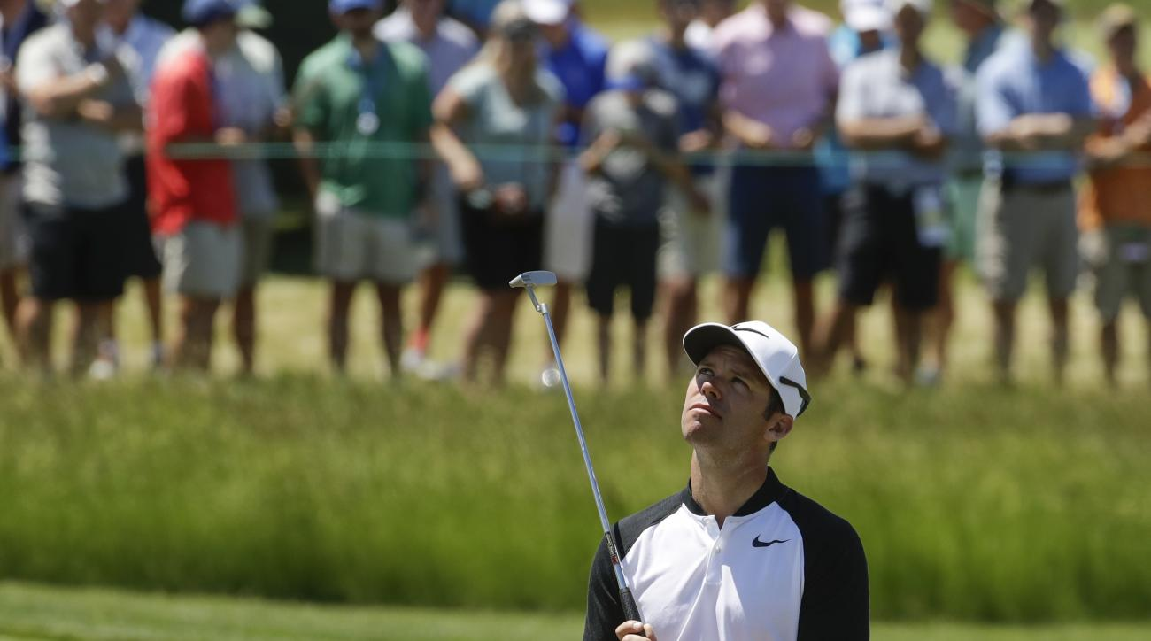 Paul Casey, of England, reacts after missing a putt on the fifth hole during the second round of the U.S. Open golf tournament Friday, June 16, 2017, at Erin Hills in Erin, Wis. (AP Photo/Charlie Riedel)