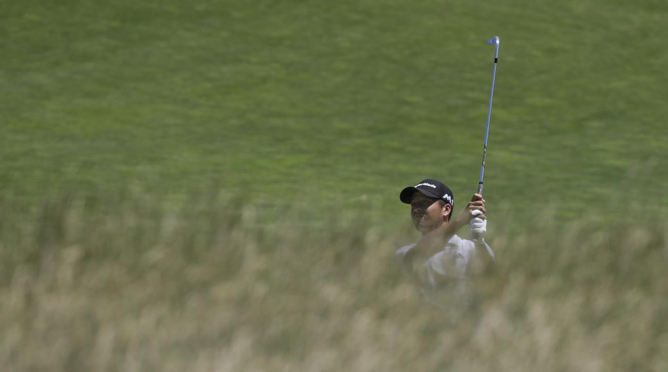 Xander Schauffele hits on the 12th hole during the second round of the U.S. Open golf tournament Friday, June 16, 2017, at Erin Hills in Erin, Wis. (AP Photo/David J. Phillip)