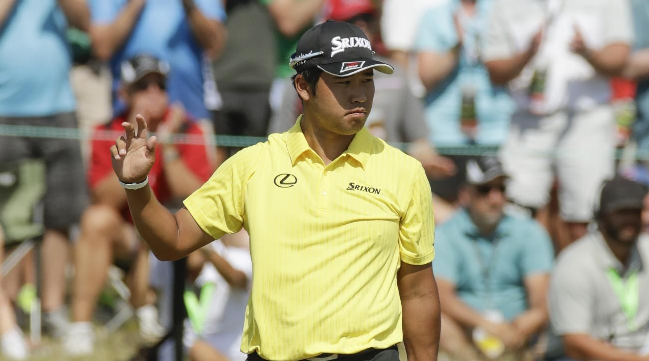 Hideki Matsuyama, of Japan, reacts to his birdie on the eighth hole during the second round of the U.S. Open golf tournament Friday, June 16, 2017, at Erin Hills in Erin, Wis. (AP Photo/Charlie Riedel)