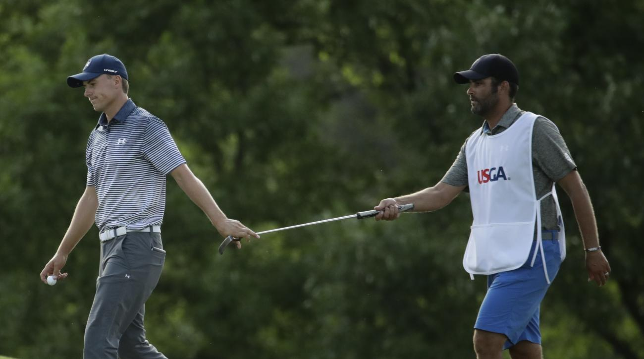 Jordan Spieth is handed a putter on the 15th hole during the second round of the U.S. Open golf tournament Friday, June 16, 2017, at Erin Hills in Erin, Wis. (AP Photo/Charlie Riedel)