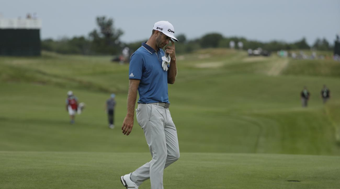 Dustin Johnson walks to the 18th green during the second round of the U.S. Open golf tournament Friday, June 16, 2017, at Erin Hills in Erin, Wis. (AP Photo/David J. Phillip)