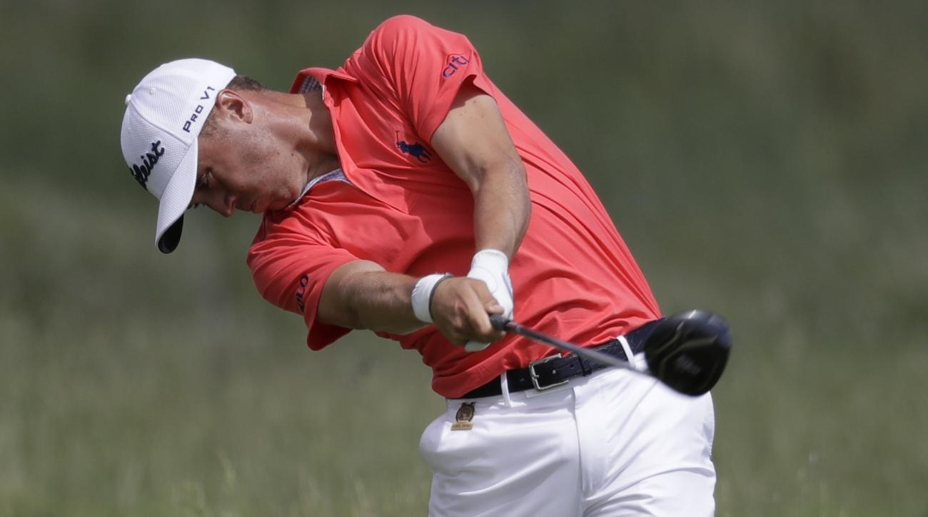 Justin Rose, of England, hits from the second tee during the fourth round of the U.S. Open golf tournament Sunday, June 18, 2017, at Erin Hills in Erin, Wis. (AP Photo/Chris Carlson)