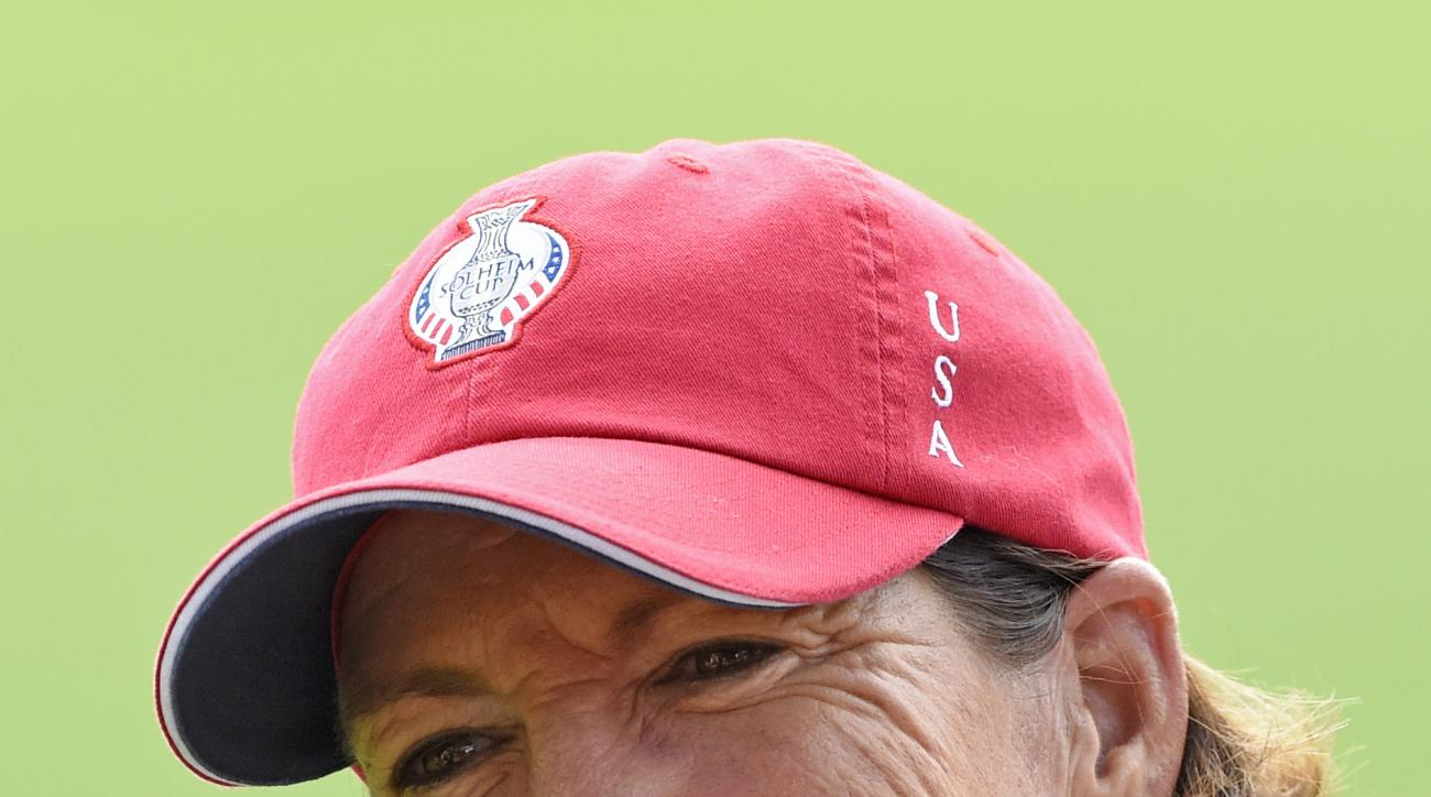 FILE - In this Sept. 18, 2015, file photo, Juli Inkster, team captain of the United States, smiles during the foursomes on Day 1 at the Solheim Cup golf tournament in St. Leon-Rot, southern Germany. The Des Moines Golf and Country Club held media day Mond