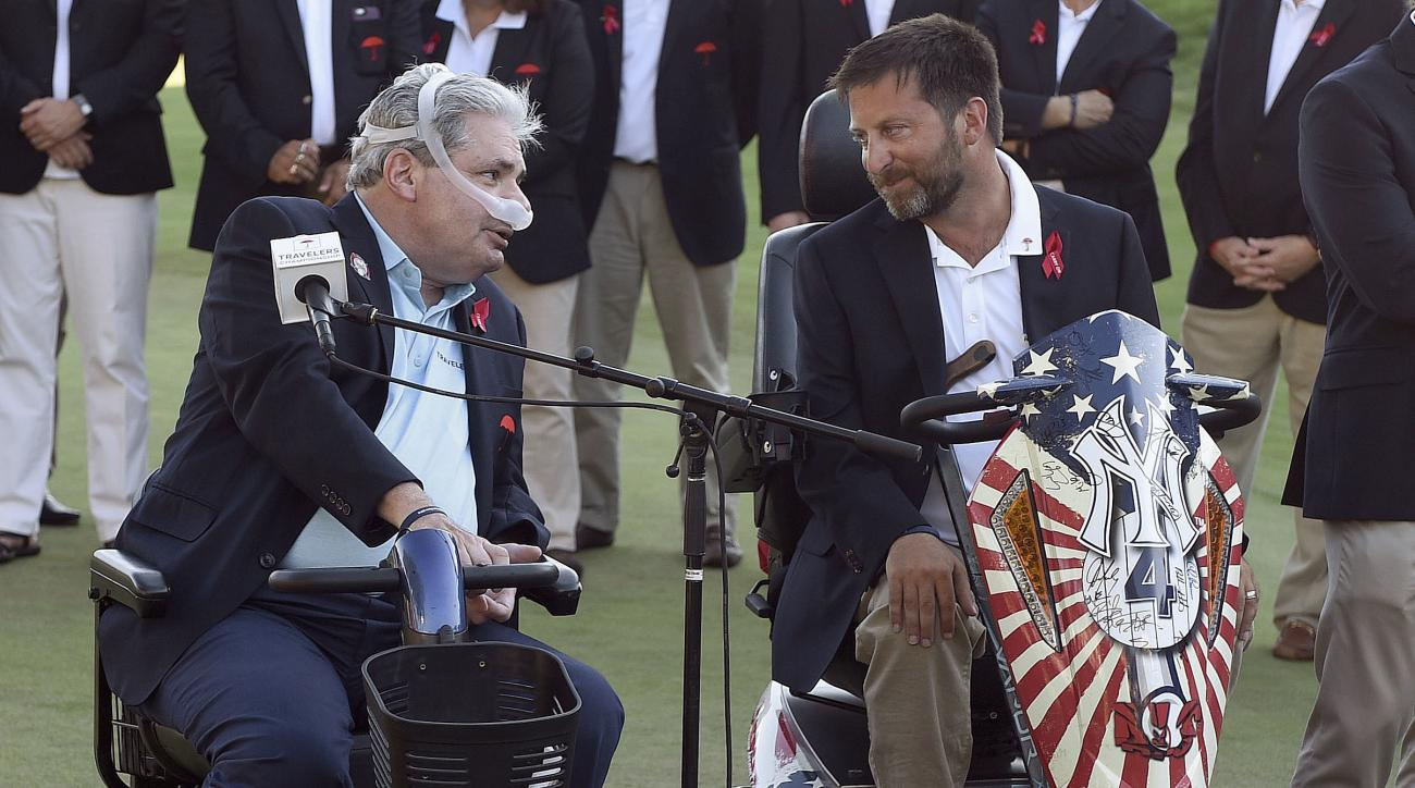 FILE - In this Aug. 7, 2016, file photo, former Travelers CEO Jay Fishman, left, speaks with Brian Savo, co-chairmen of the Travelers Championship PGA golf tournament, on the day of the tournament's final round in Cromwell, Conn. Savo was instrumental in