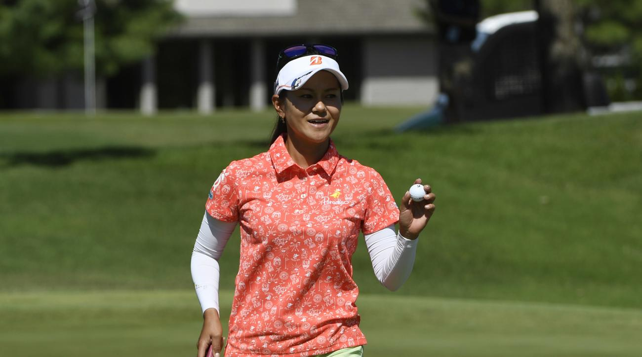 Ai Miyazato, of Japan, waves to fans after sinking her putt on the 10th hole during the LPGA Wal-Mart NW Arkansas Championship golf tournament at Pinnacle Country Club in Rogers, Ark., Sunday, June 25, 2017. (AP Photo/Michael Woods)