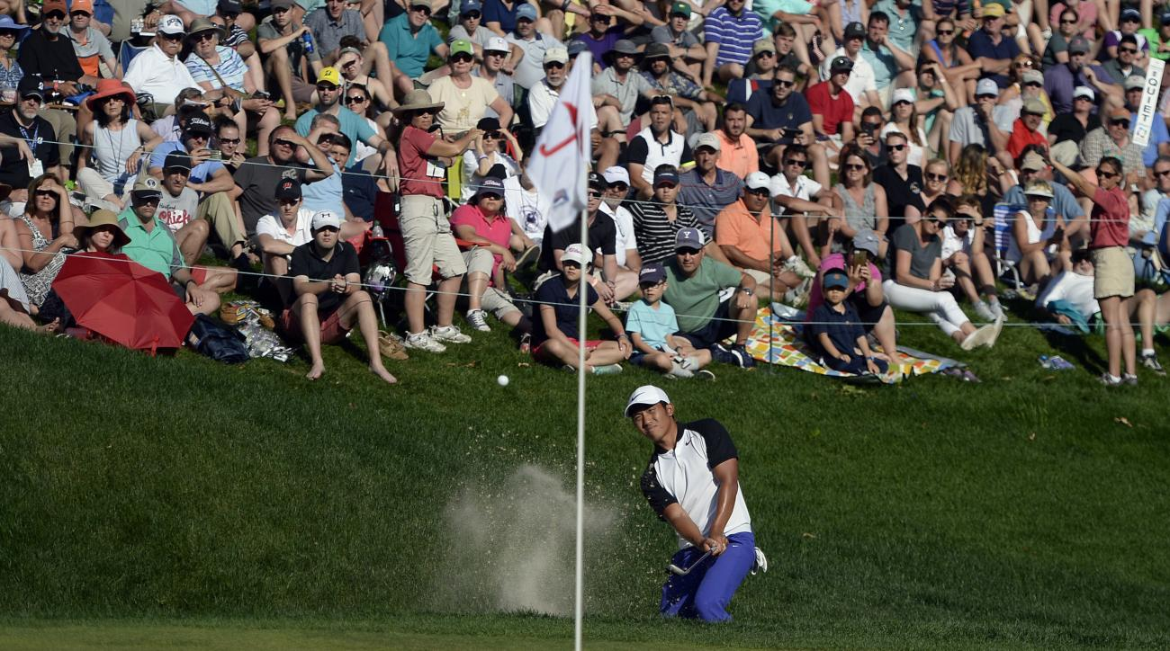 C.T. Pan, of Taiwan, hits from a bunker on the 18th hole during the final round of the Travelers Championship golf tournament, Sunday, June 25, 2017, in Cromwell, Conn. (AP Photo/Jessica Hill)