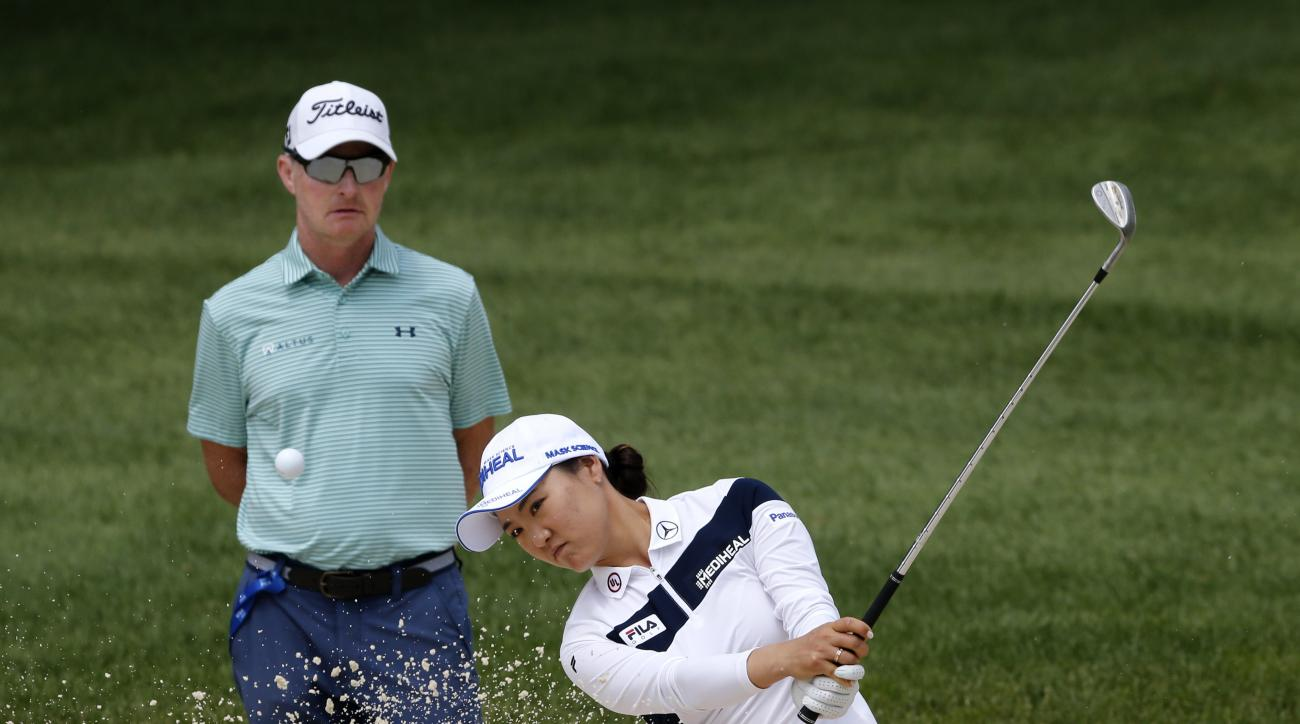 So Yeon Ryu of South Korea hits out of a bunker as coach Cameron McCormick watches during a practice round of the 2017 Women's PGA Championship golf tournament at the Olympia Fields Country Club Wednesday, June 28, 2017, in Olympia Fields, Ill. (AP Photo/