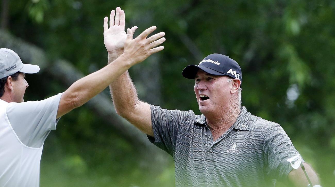 Duffy Waldorf, right, celebrates with Billy Andrade after hitting a hole-in-one on the third hole during the first round of the U.S. Senior Open golf tournament, Thursday, June 29, 2017, in Peabody, Mass. (AP Photo/Michael Dwyer)