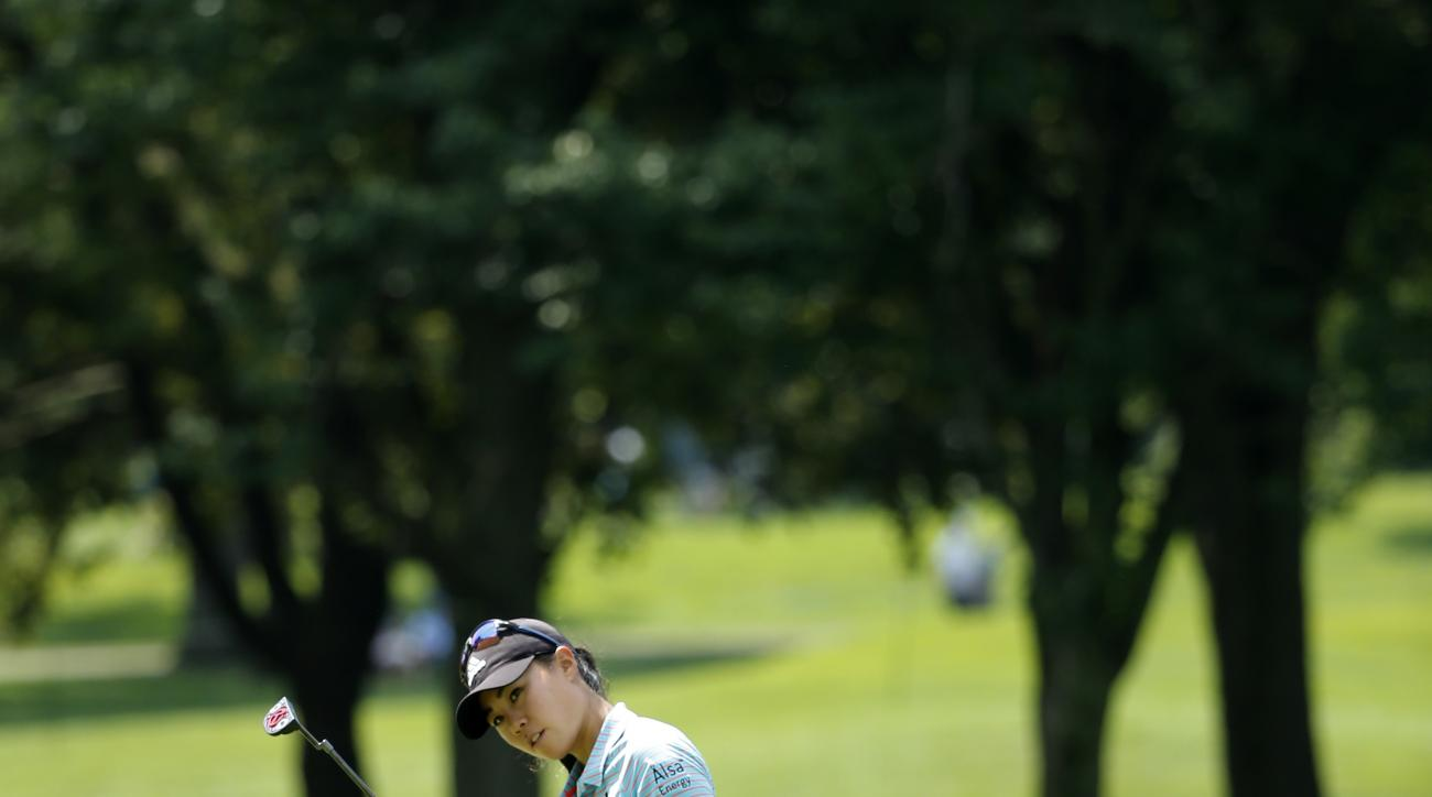 Danielle Kang reacts to her birdie attempt on the 10th green during the second round of the Women's PGA Championship golf tournament at Olympia Fields Country Club Friday, June 30, 2017, in Olympia Fields, Ill. (AP Photo/Charles Rex Arbogast)