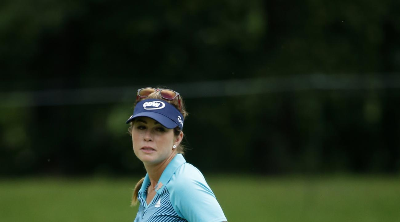 Paula Creamer drops her putter after missing a birdie on the fourth hole during the second round of the Women's PGA Championship golf tournament at Olympia Fields Country Club Friday, June 30, 2017, in Olympia Fields, Ill. (AP Photo/Charles Rex Arbogast)
