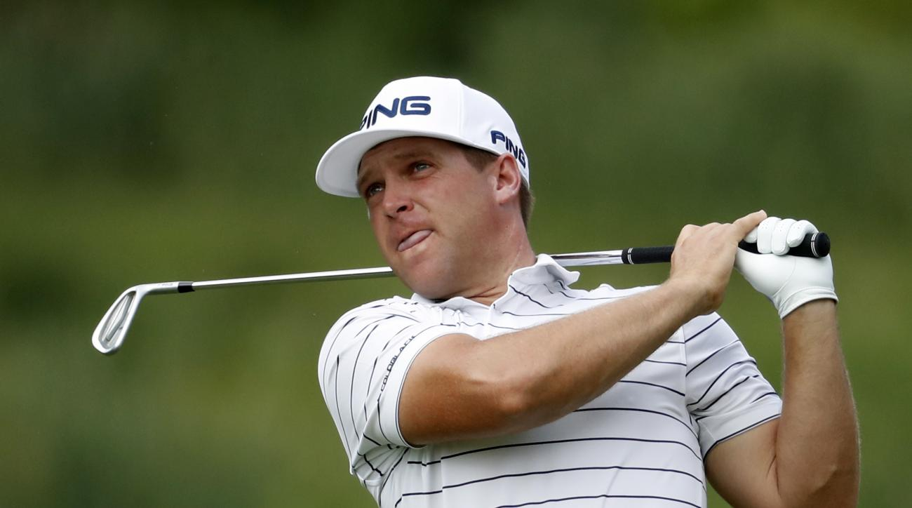Daniel Summerhays watches his shot from the sixth fairway during the Quicken Loans National golf tournament, Sunday, July 2, 2017, in Potomac, Md. (AP Photo/Alex Brandon)