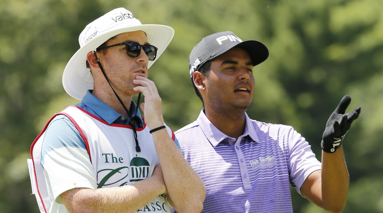 Sebastian Munoz, right, of Colombia, talks with his caddie on the third tee during the final round of the Greenbrier Classic PGA Tour golf tournament Sunday, July 9, 2017, in White Sulphur Springs, W.Va. (AP Photo/Steve Helber)