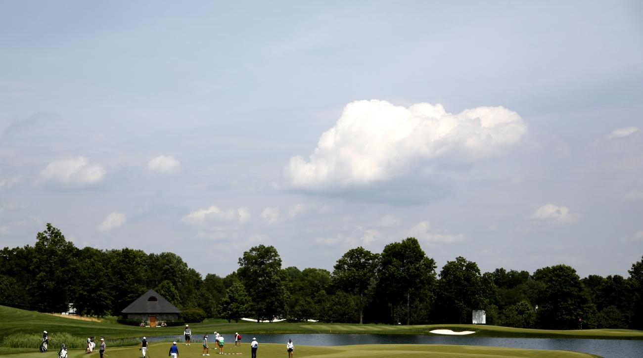 Golfers putt on the 6th green during a practice round at the U.S. Women's Open Golf Championship at Trump National Golf Club in Bedminster, N.J., Wednesday, July 12, 2017. (AP Photo/Seth Wenig)