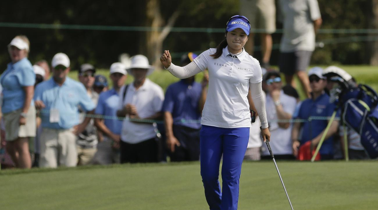 Hye-Jin Choi, of South Korea, reacts after sinking a putt for birdie on the seventh green during the final round of the U.S. Women's Open Golf tournament Sunday, July 16, 2017, in Bedminster, N.J. (AP Photo/Seth Wenig)