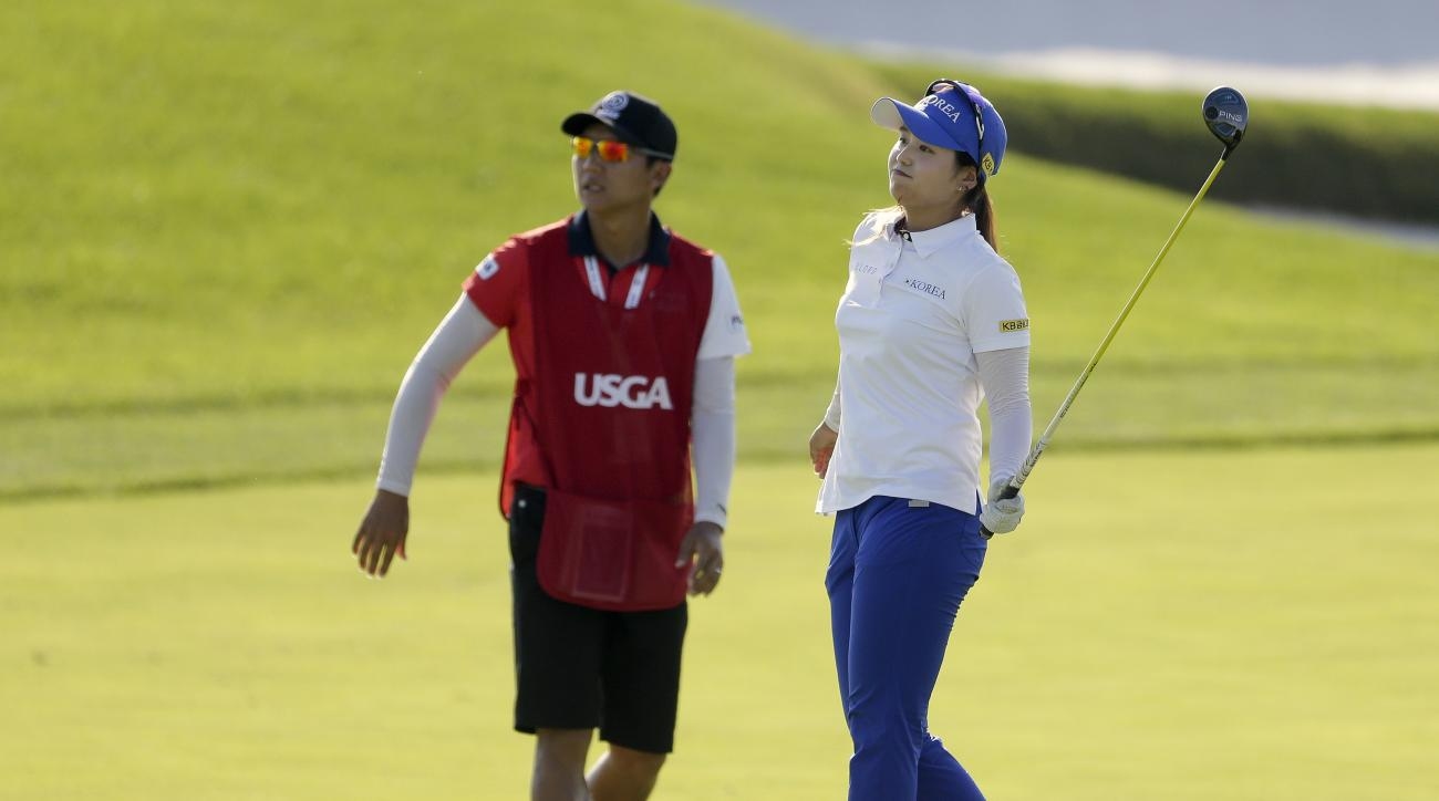South Korea's Hye-Jin Choi reacts after a shot on the 15th fairway during the final round of the U.S. Women's Open Golf tournament Sunday, July 16, 2017, in Bedminster, N.J. (AP Photo/Seth Wenig)