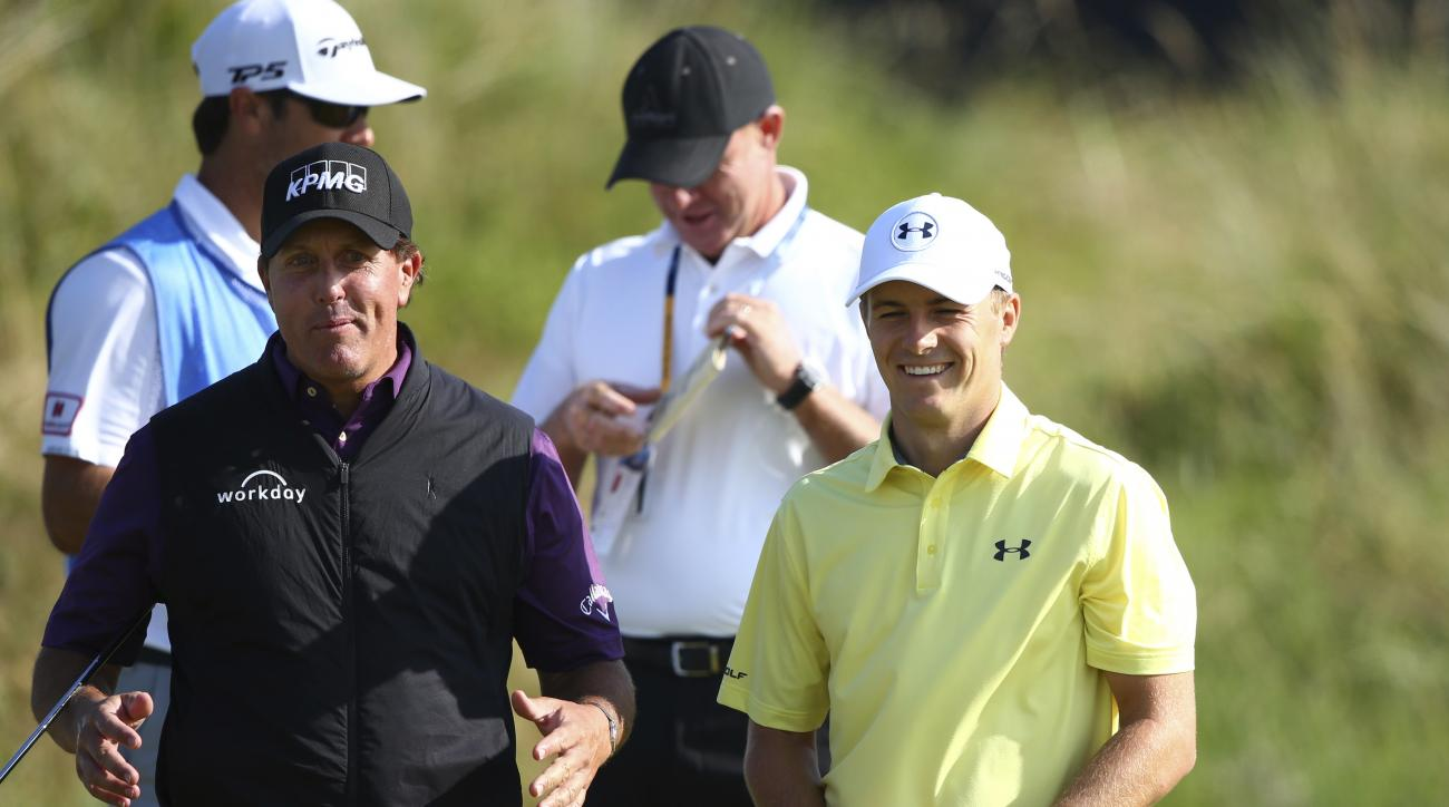 Phil Mickelson of the United States, left, gestures as he talks to Jordan Spieth of the United States during a practice round ahead of the British Open Golf Championship, at Royal Birkdale, Southport, England Tuesday, July 18, 2017. (AP Photo/Dave Thompso