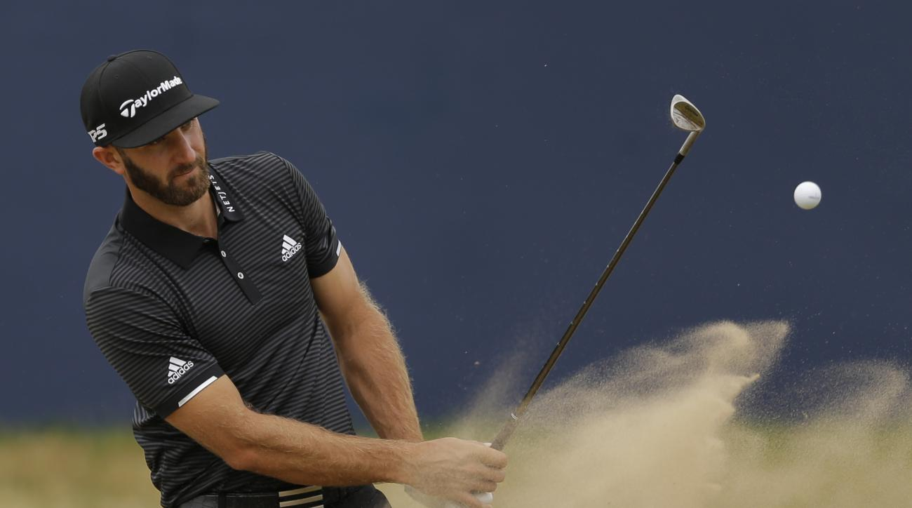 Dustin Johnson of the United States plays out of the bunker on the 18th hole during a practice round ahead of the British Open Golf Championship, at Royal Birkdale, Southport, England Wednesday, July 19, 2017. (AP Photo/Alastair Grant)