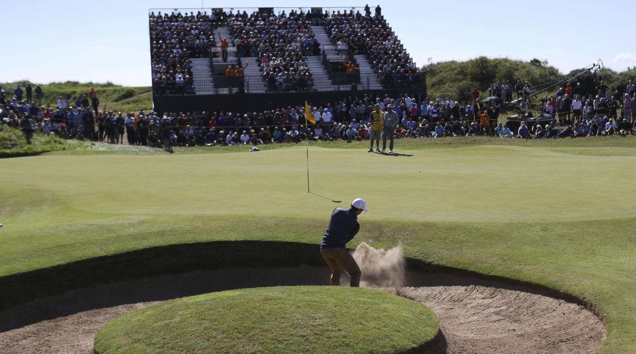 Northern Ireland's Rory McIlroy plays out of the bunker on the 7th hole during the first round of the British Open Golf Championship, at Royal Birkdale, Southport, England Thursday, July 20, 2017. (AP Photo/Peter Morrison)