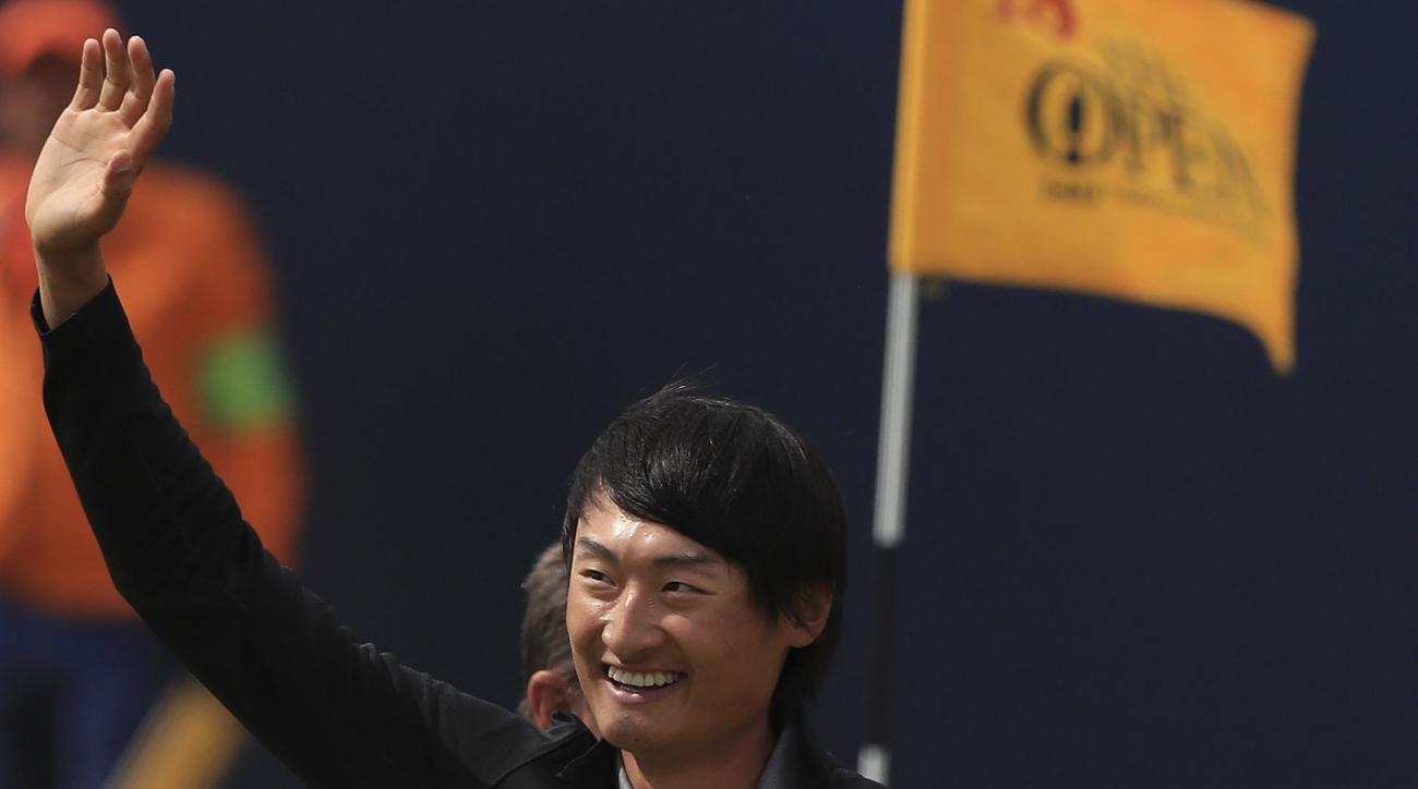 China's Li Haotong celebrates on the 18th during the final round of the British Open Golf Championship, at Royal Birkdale, Southport, England, Sunday July 23, 2017. (Peter Byrne/PA via AP)