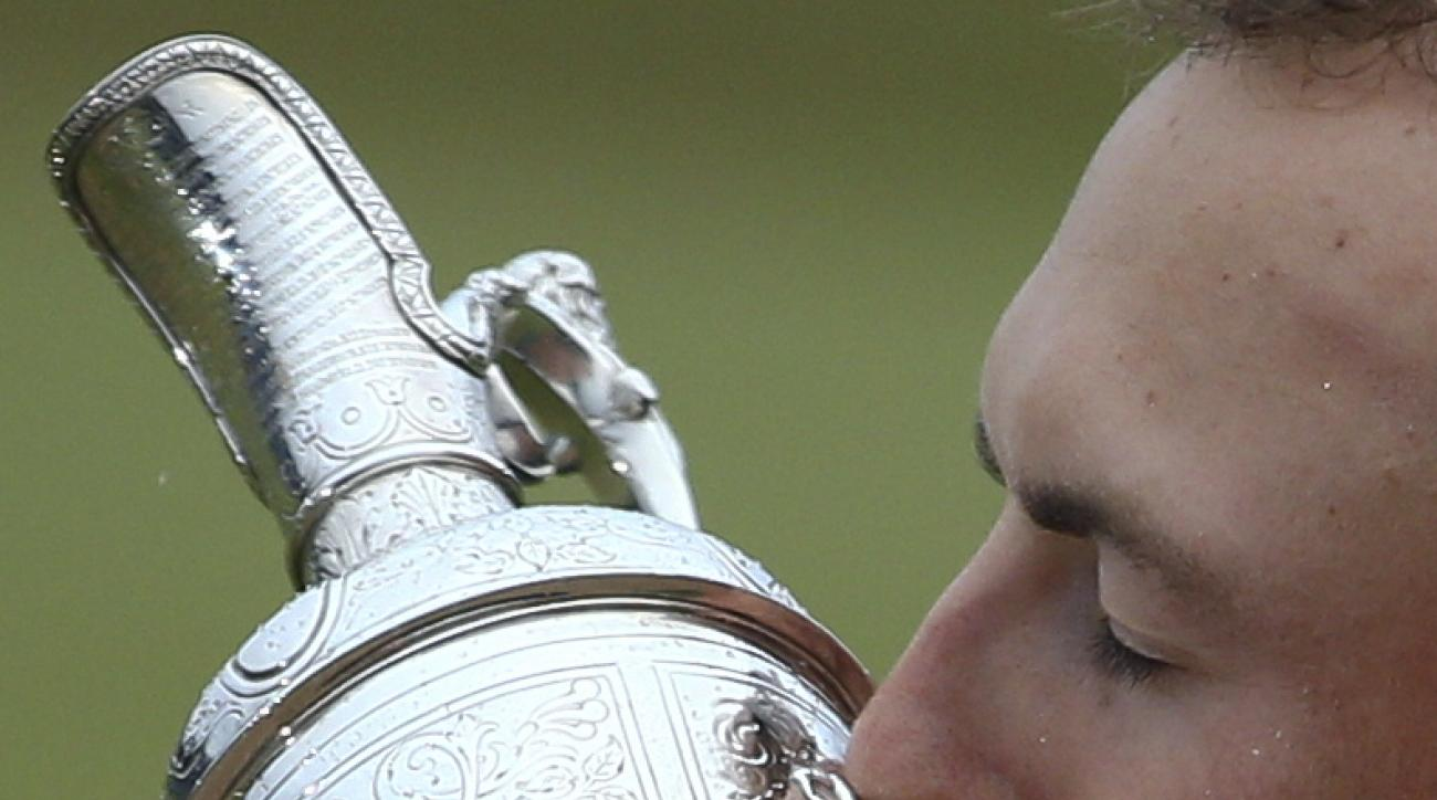 Jordan Spieth of the United States kisses the trophy after winning the British Open Golf Championships at Royal Birkdale, Southport, England, Sunday July 23, 2017. (AP Photo/Dave Thompson)