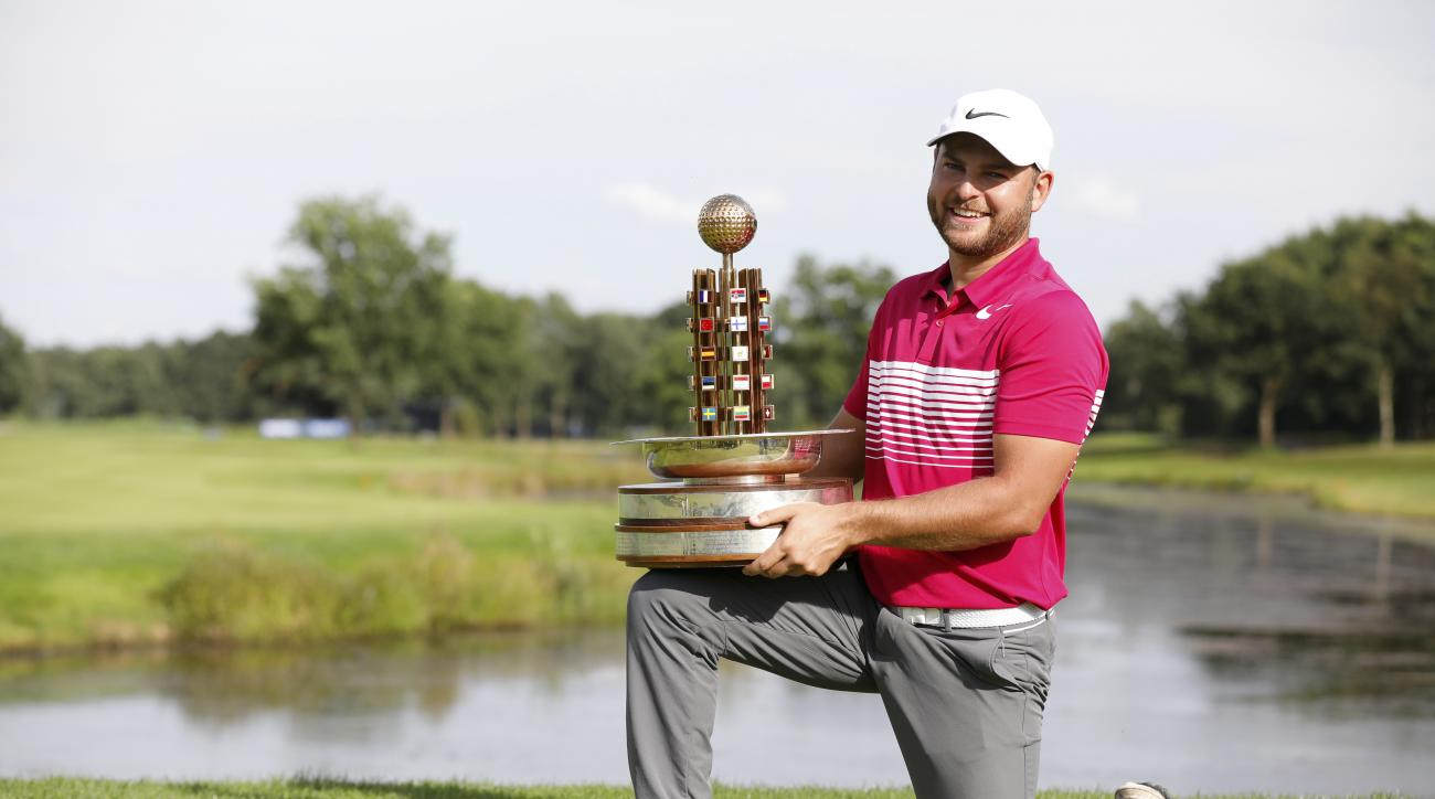 Britain's Jordan Smith poses with the trophy after he won the European  PGA Championships  golf tournament in Winsen an der Luhe, Germany, Sunday July 30, 2017.  (Georg Wendt/dpa via AP)
