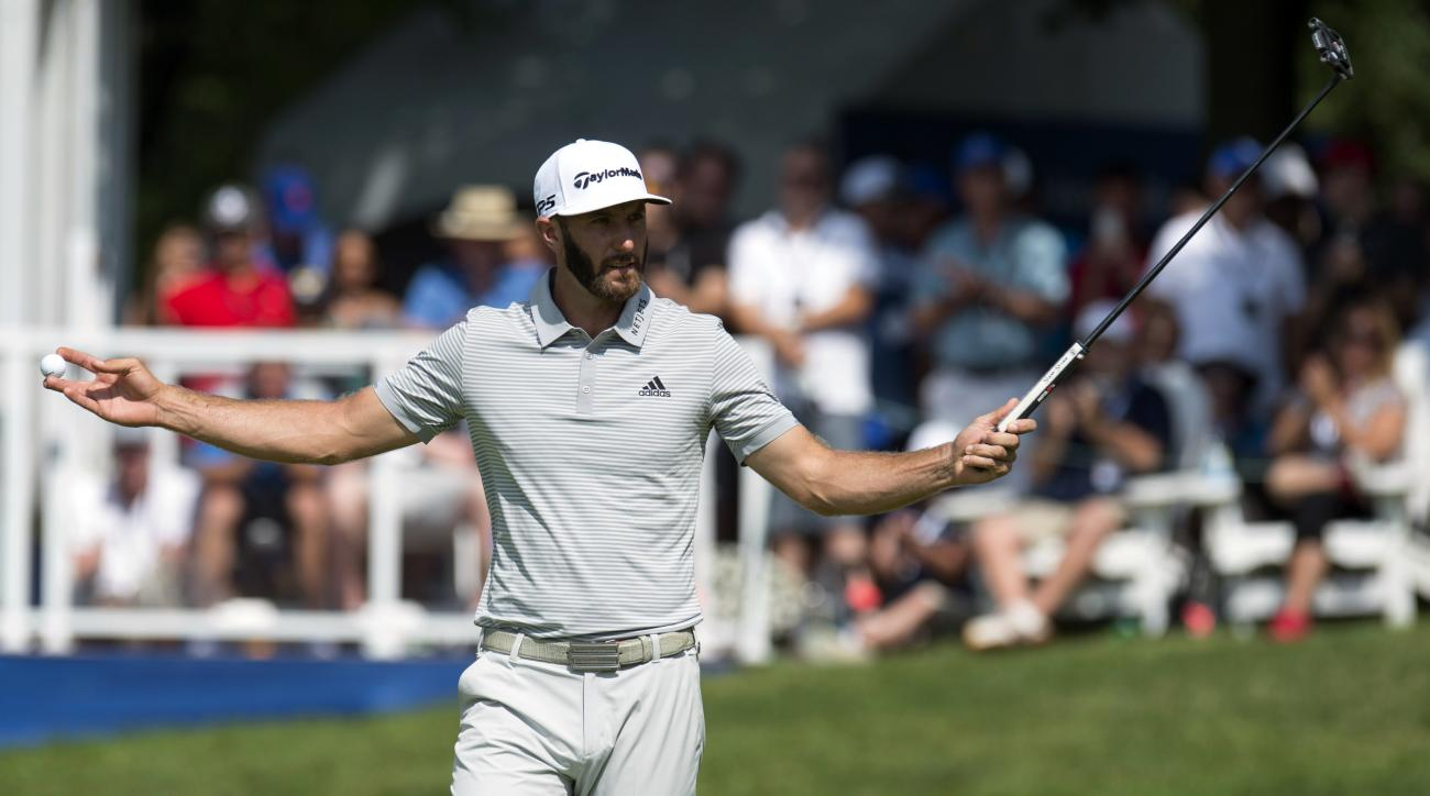 Dustin Johnson reacts after making an eagle on the 16th hole during the final round of the Canadian Open golf tournament at Glen Abbey Golf Club in Oakville, Ontario, Sunday, July 30, 2017. (Frank Gunn/The Canadian Press via AP)