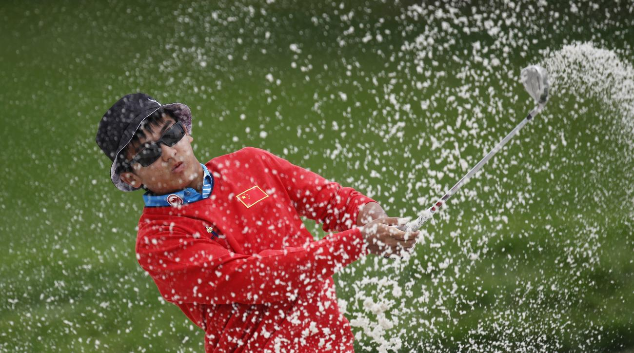 Dou Zecheng of China hits a shot from a bunker on the 11th hole during the final round of the HSBC Champions golf tournament at the Sheshan International Golf Club in Shanghai, China, Saturday, Nov. 9, 2014. (AP Photo)