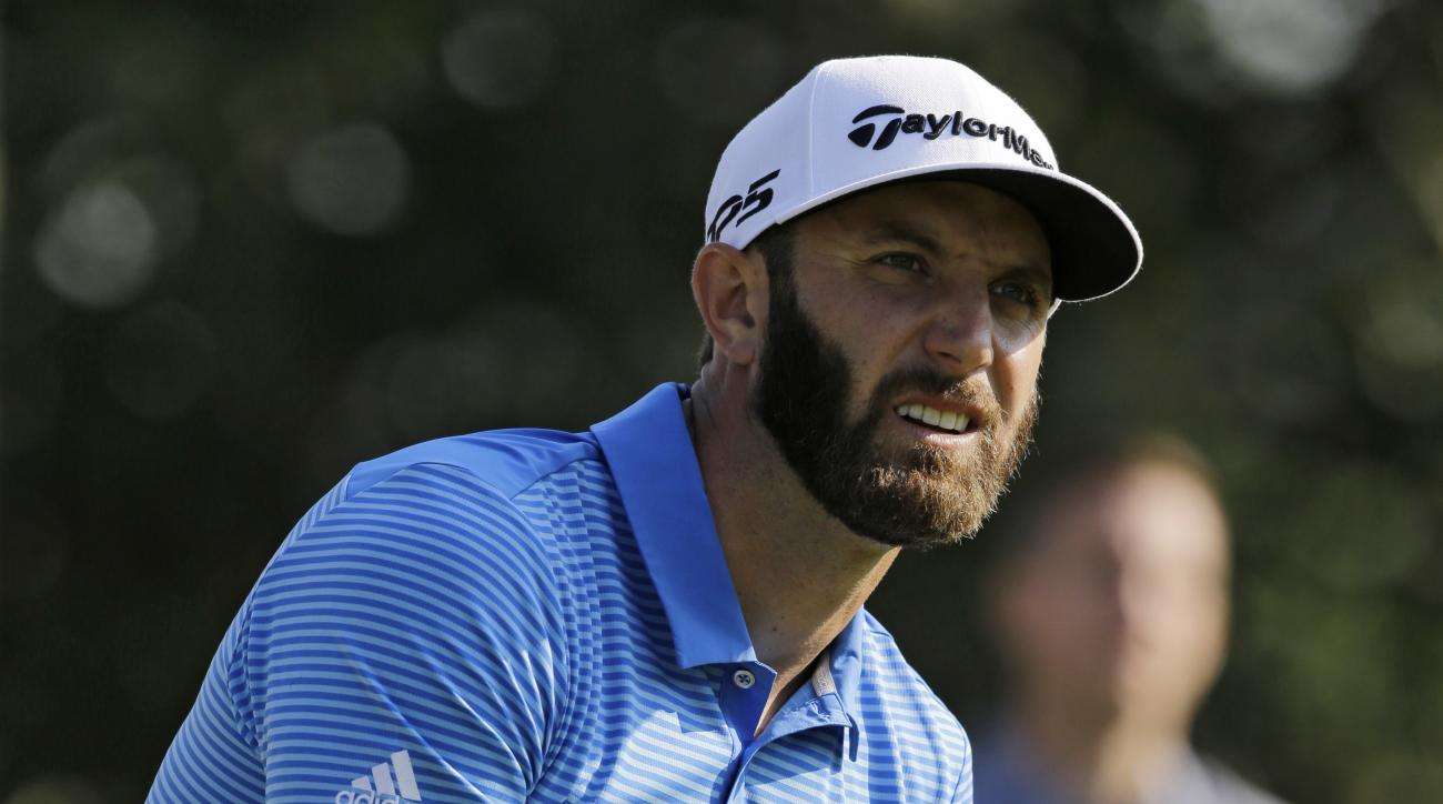 Dustin Johnson watches his tee shot on the 14th hole during the first round of the Bridgestone Invitational golf tournament at Firestone Country Club, Thursday, Aug. 3, 2017, in Akron, Ohio. (AP Photo/Tony Dejak)