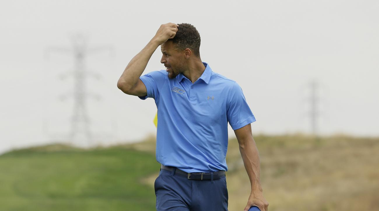 Golden State Warriors NBA basketball player Stephen Curry scratches his head after finishing the first round on the ninth green during the Web.com Tour's Ellie Mae Classic golf tournament Thursday, Aug. 3, 2017, in Hayward, Calif. Curry shot a 4-over-par