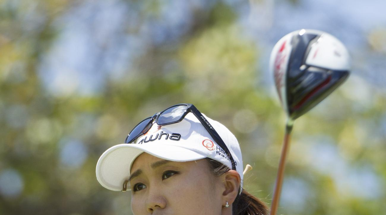 I.K. Kim of South Korea watches the flight of her golf ball after hitting off the second tee in the final round of the LPGA Lotte Championship golf tournament at Ko Olina Golf Club, Saturday, April 18, 2015, in Kapolei, Hawaii. (AP Photo/Eugene Tanner)