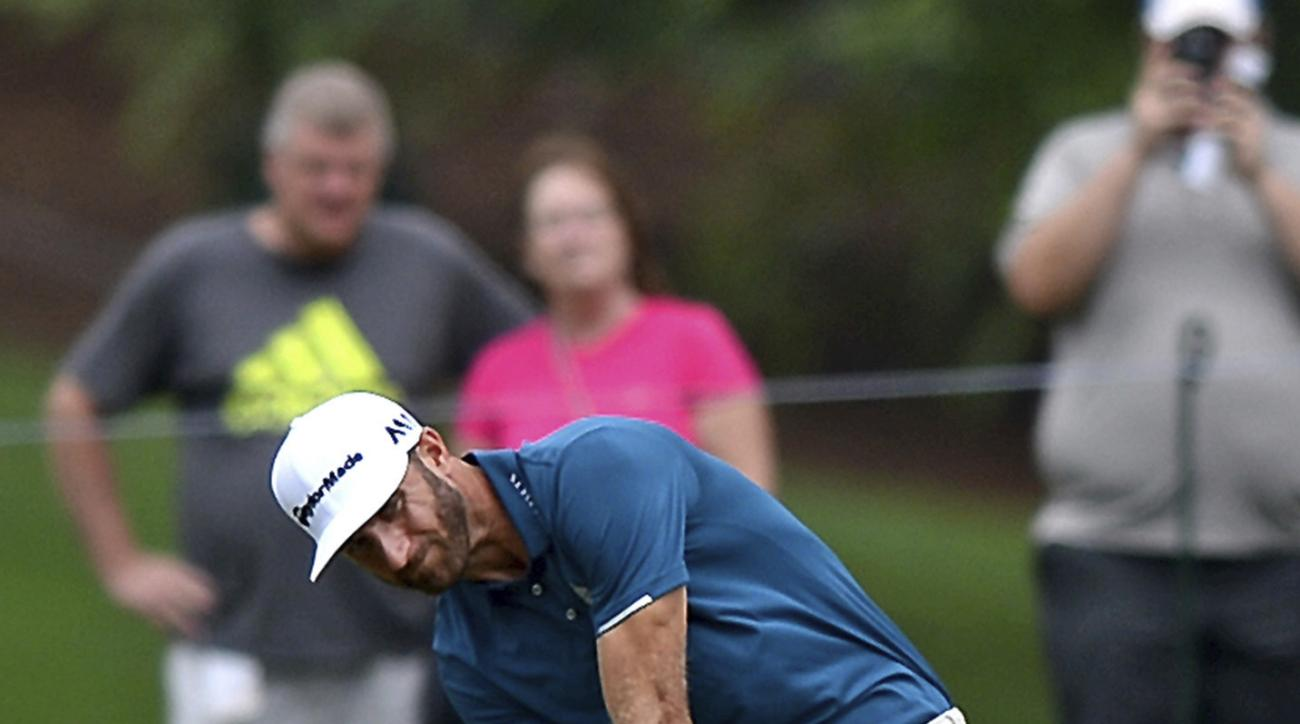 Dustin Johnson hits his second shot from a fairway during practice for the PGA Championship golf tournament at Quail Hollow Club in Charlotte, N.C., Monday, Aug. 7, 2017. (Jeff Siner/The Charlotte Observer via AP)/The Charlotte Observer via AP)