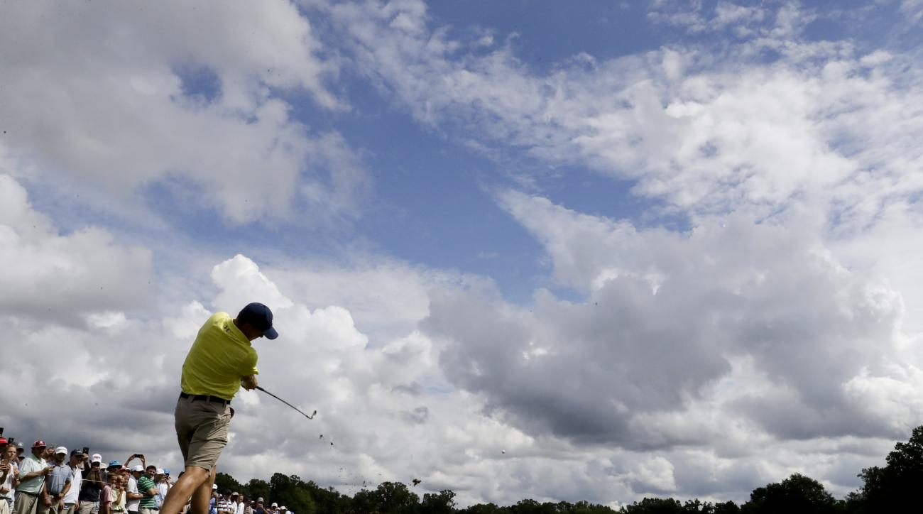 Jordan Spieth hits to the 17th green during a practice round at the PGA Championship golf tournament at the Quail Hollow Club Tuesday, Aug. 8, 2017, in Charlotte, N.C. (AP Photo/Chris Carlson)