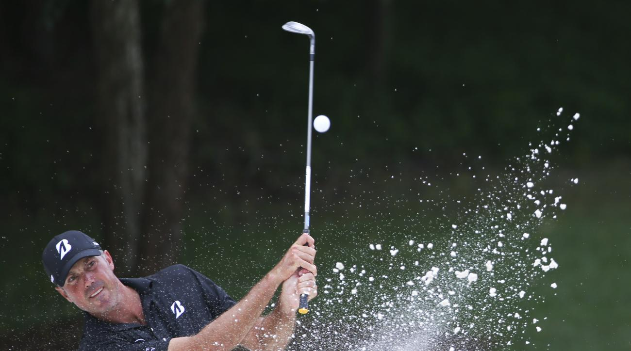 Matt Kuchar hits from the bunker on the 12th hole during a practice round at the PGA Championship golf tournament at the Quail Hollow Club Thursday, April 13, 2017, in Charlotte, N.C. (AP Photo/John Bazemore)
