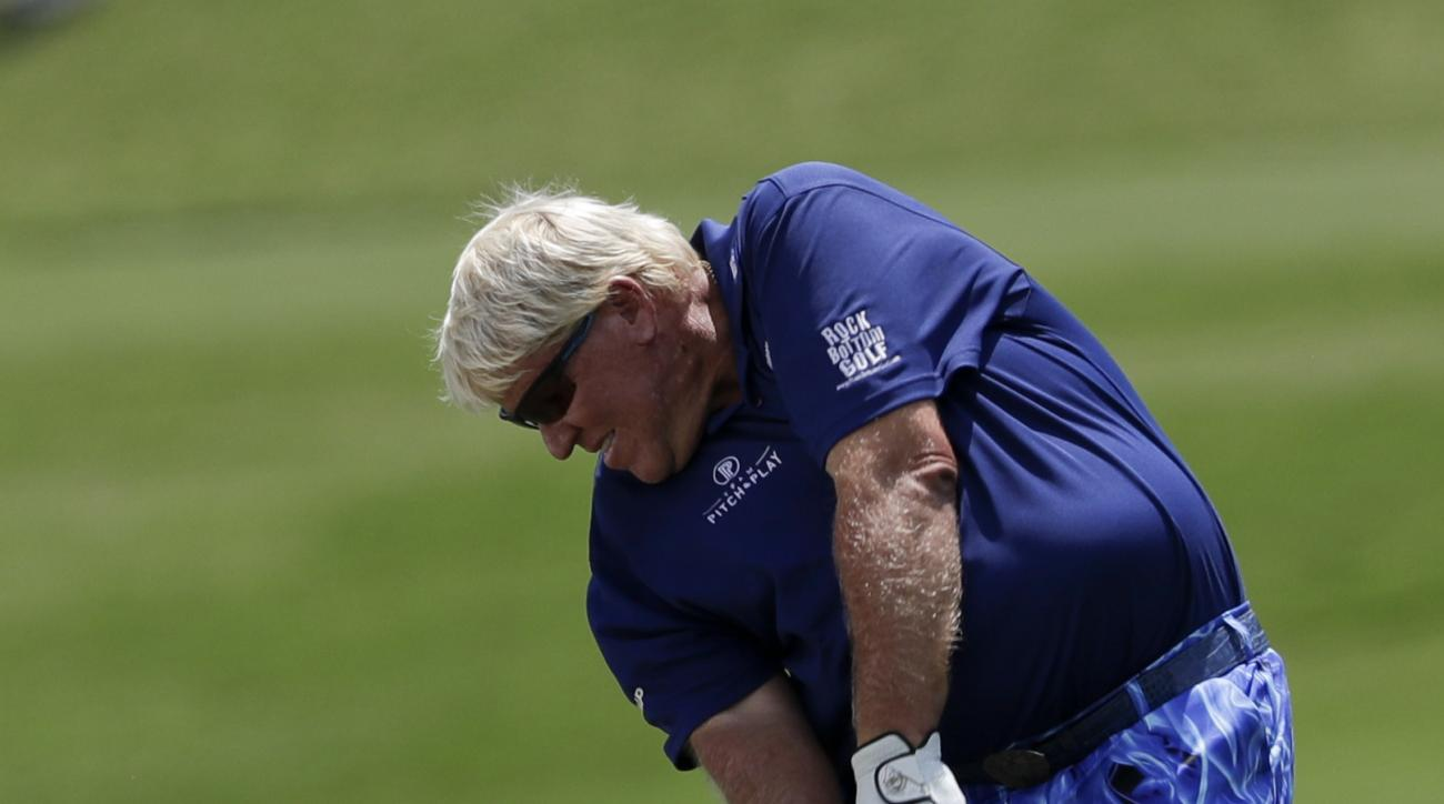 John Daly hits from the fairway on the 18th hole during the first round of the PGA Championship golf tournament at the Quail Hollow Club Thursday, Aug. 10, 2017, in Charlotte, N.C. (AP Photo/John Bazemore)