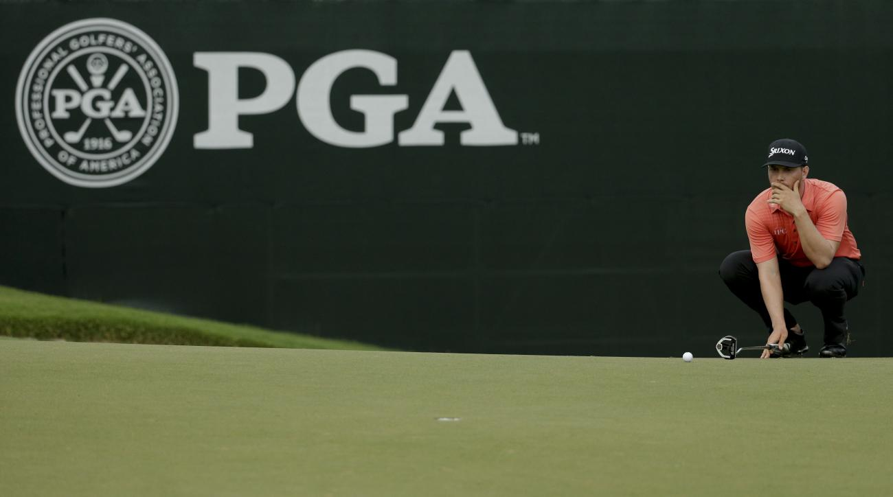 Chris Stroud lines up his putt on the second hole during the second round of the PGA Championship golf tournament at the Quail Hollow Club Friday, Aug. 11, 2017, in Charlotte, N.C. (AP Photo/Chuck Burton)