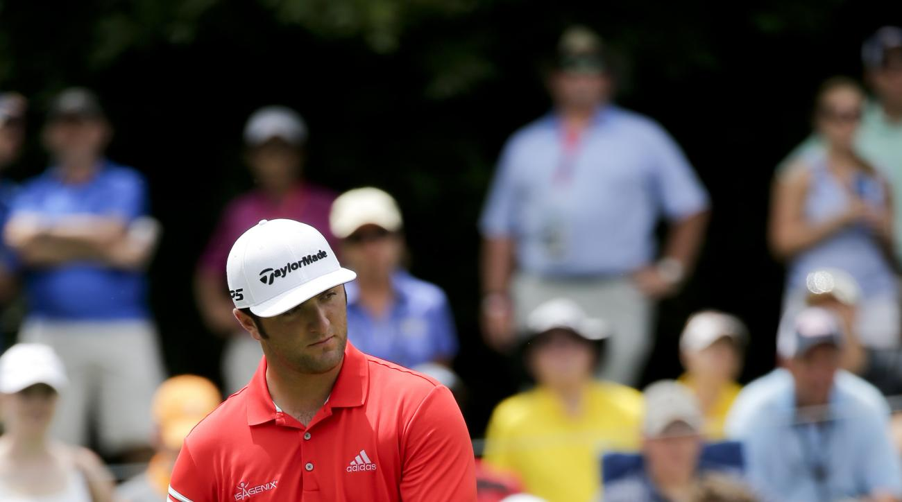 Jon Rahm, of Spain, watches his putt on the eighth hole during the final round of the PGA Championship golf tournament at the Quail Hollow Club Sunday, Aug. 13, 2017, in Charlotte, N.C. (AP Photo/Chuck Burton)