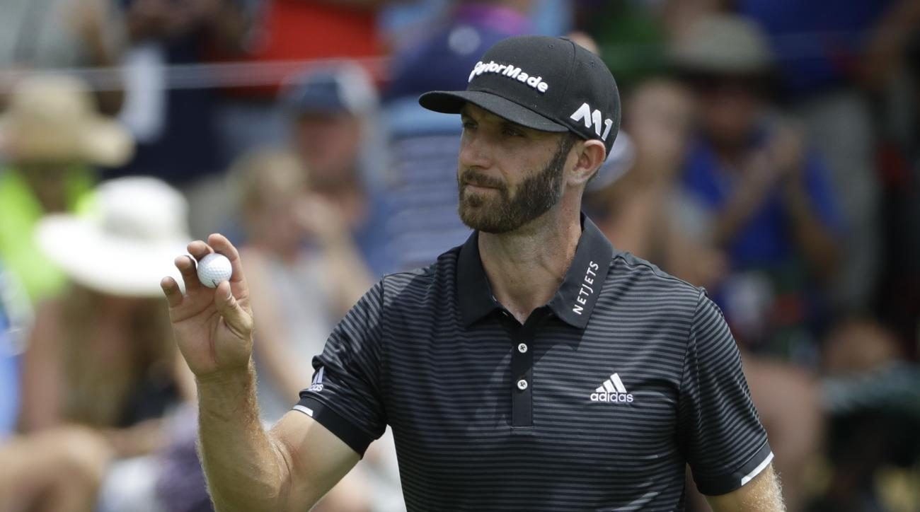 Dustin Johnson waves on the 15th hole during the final round of the PGA Championship golf tournament at the Quail Hollow Club Sunday, Aug. 13, 2017, in Charlotte, N.C. (AP Photo/Chris O'Meara)
