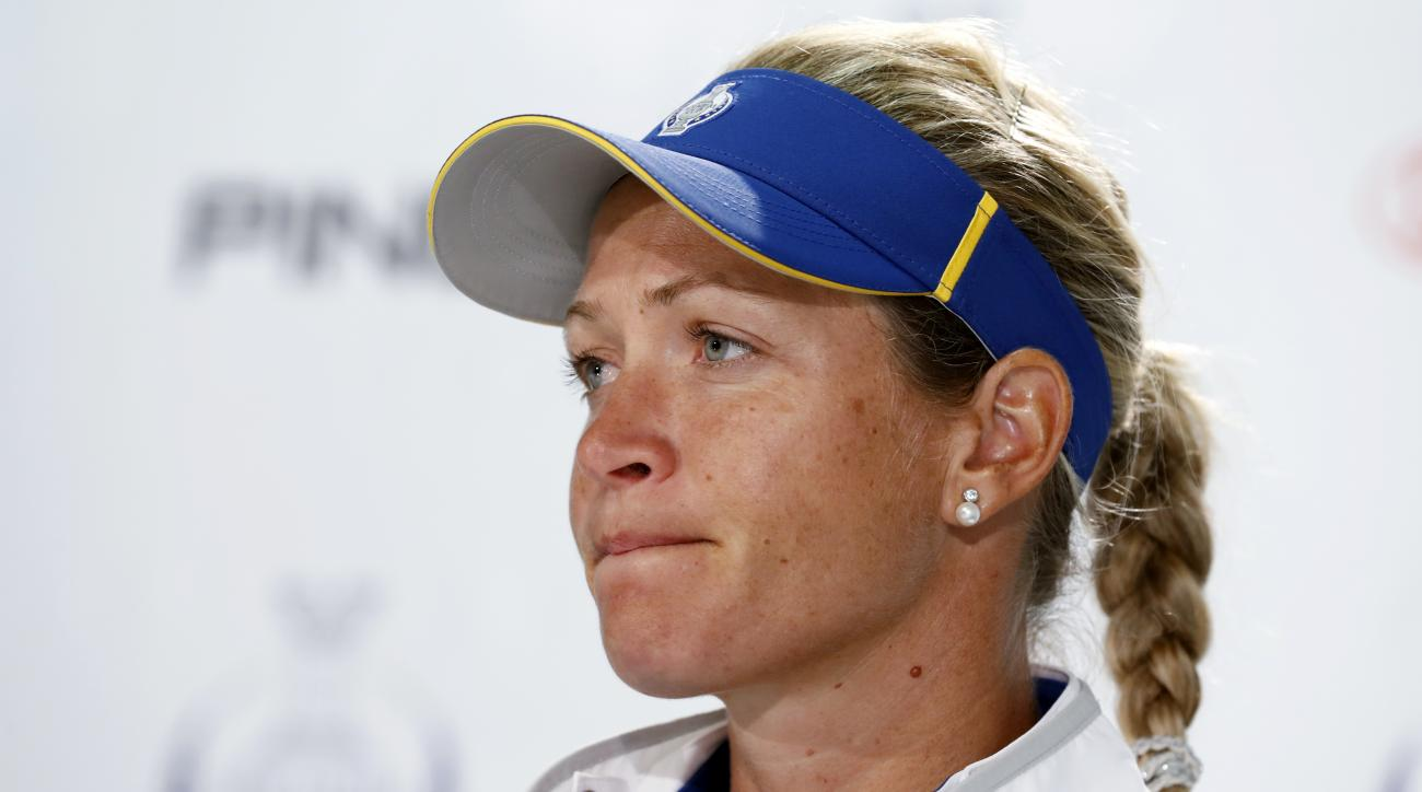Europe's Suzann Pettersen, of Norway, looks on during a news conference for the Solheim Cup golf tournament, Wednesday, Aug. 16, 2017, in West Des Moines, Iowa. Pettersen has pulled out of this weekend's Solheim Cup because of a back injury. (AP Photo/Cha