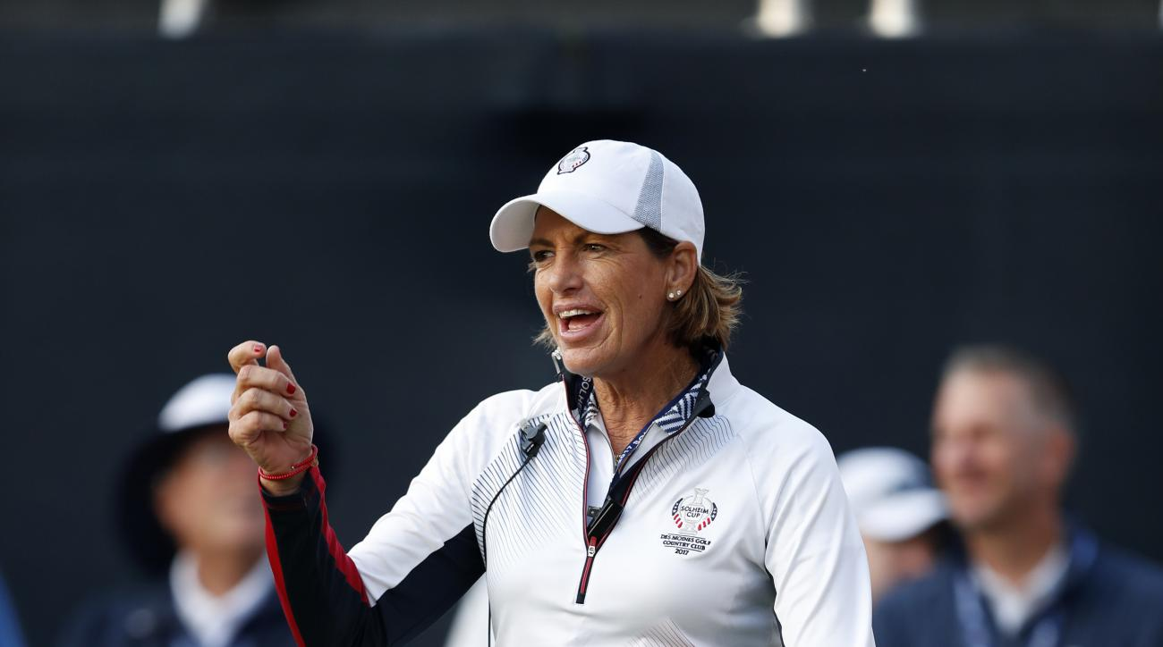 U.S. captain Juli Inkster dances on the first tee before the start of foursomes match play in the Solheim Cup golf tournament, Saturday, Aug. 19, 2017, in West Des Moines, Iowa. (AP Photo/Charlie Neibergall)