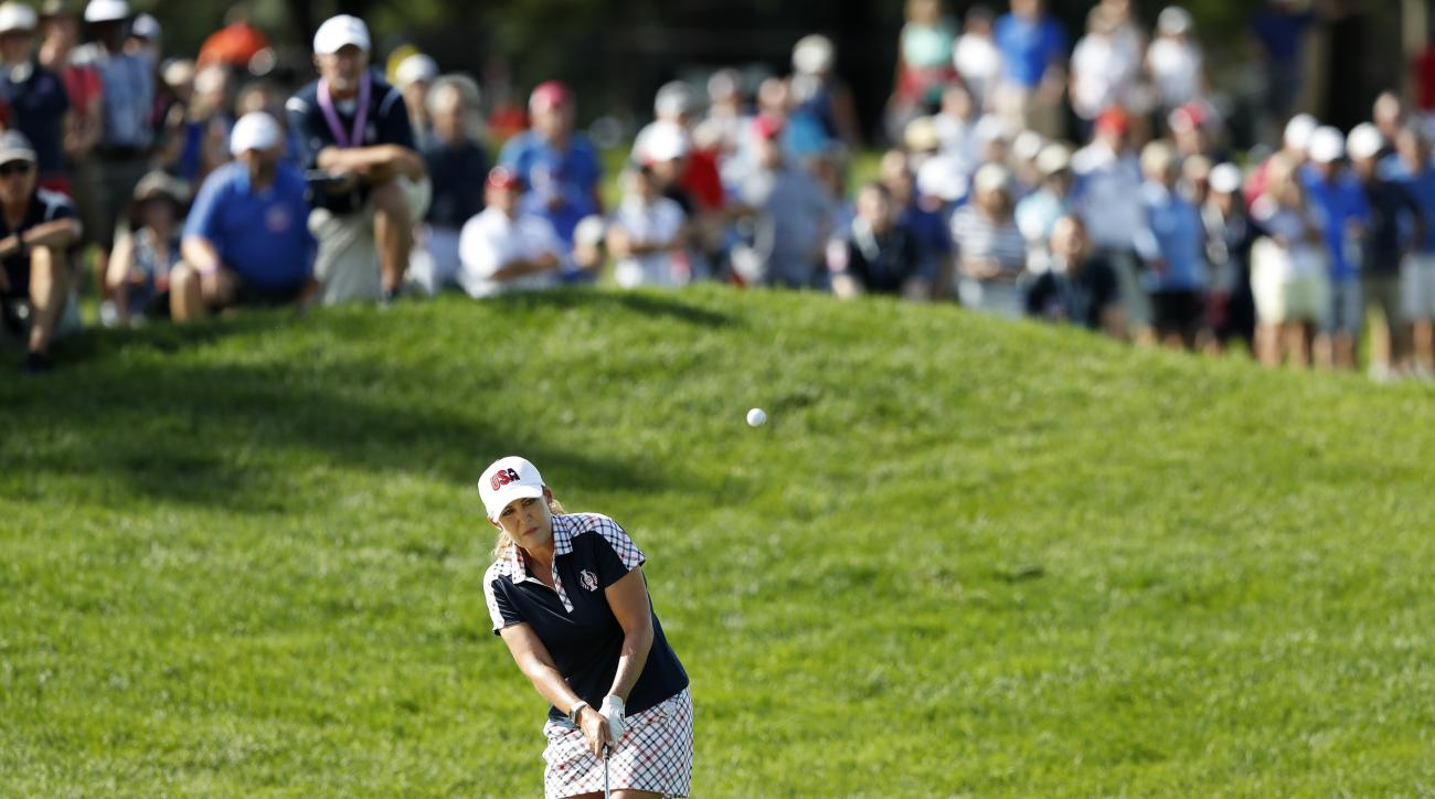 United States' Cristie Kerr hits to the first green during her singles match against Europe's Mel Reid, of England, in the Solheim Cup golf tournament, Sunday, Aug. 20, 2017, in West Des Moines, Iowa. (AP Photo/Charlie Neibergall)