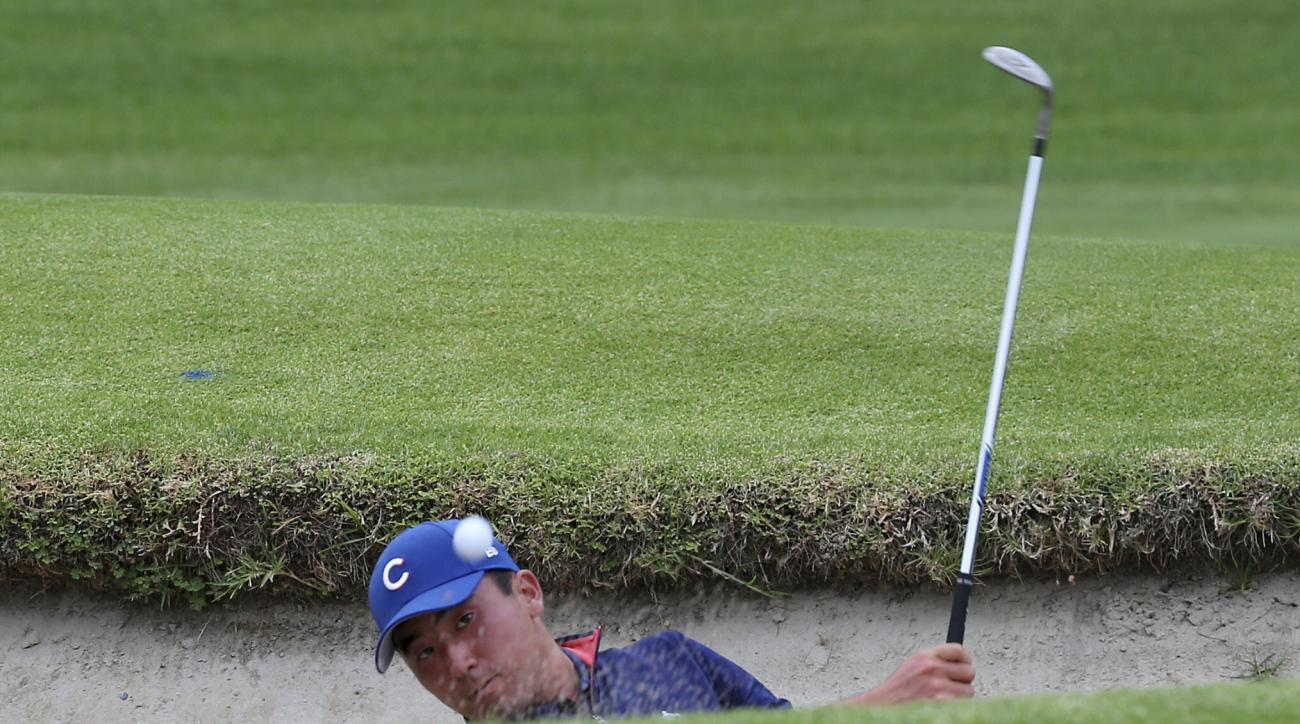 Doug Ghim hits out of a bunker on the first hole during the championship round of the USGA Amateur Golf Championship at the Riviera Country Club in the Pacific Palisades area of Los Angeles, Sunday, Aug. 20, 2017. (AP Photo/Reed Saxon)