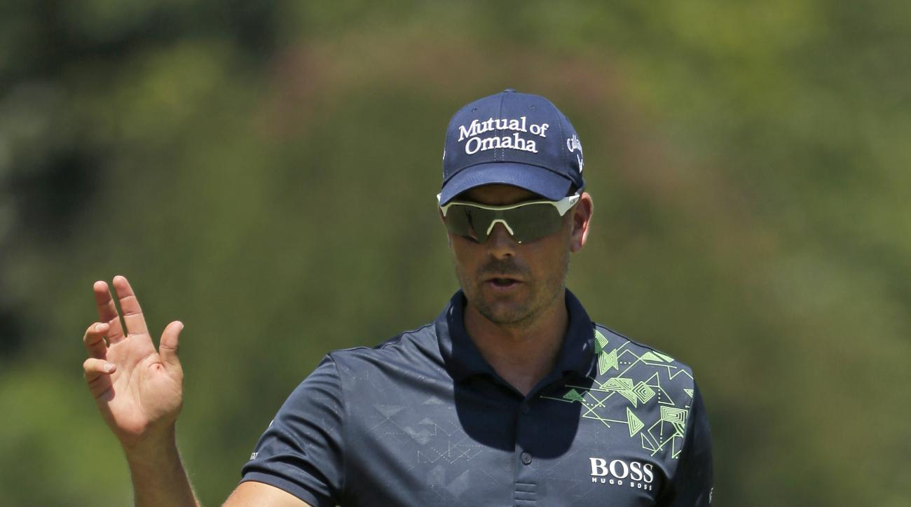 Henrik Stenson reacts to making a birdie putt on the first hole during the final round of the Wyndham Championship golf tournament in Greensboro, N.C., Sunday, Aug. 20, 2017. (AP Photo/Chuck Burton)