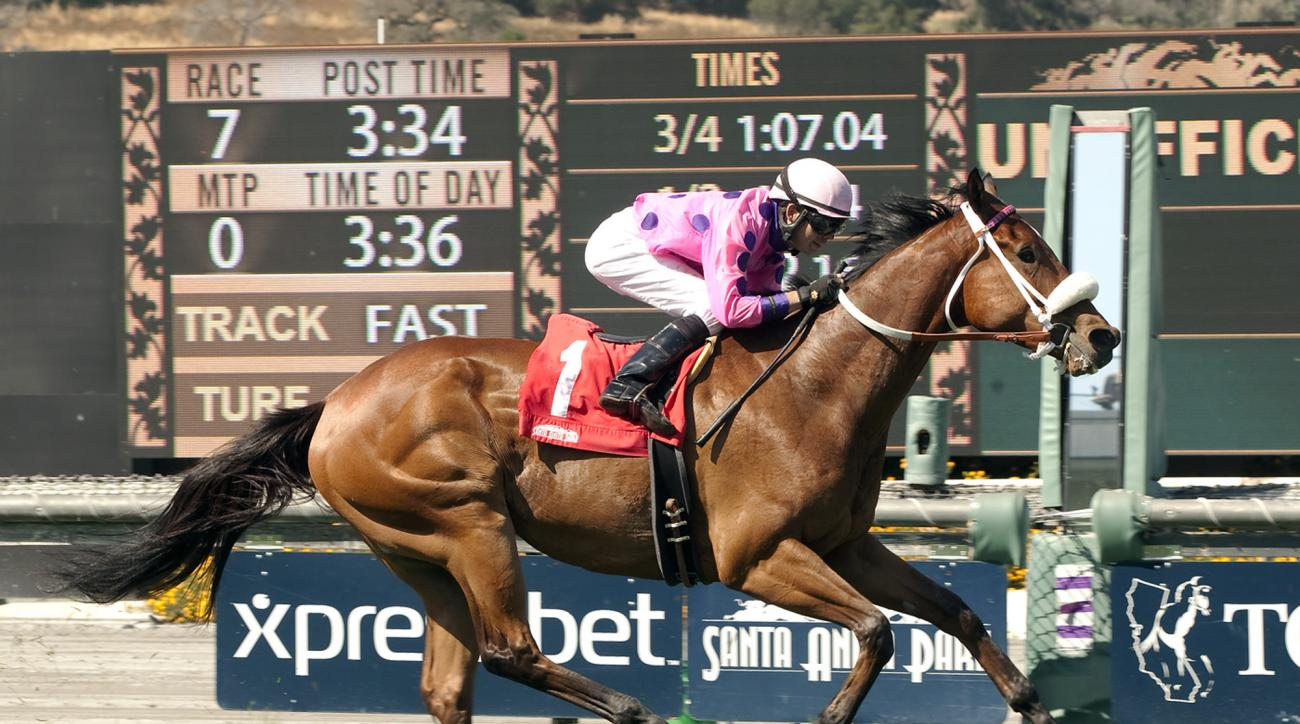 In this image provided by Benoit Photo, Get Happy Mister, with Tyler Baze aboard, wins the Grade III, $100,000 San Simeon Stakes horse race Sunday, April 19, 2015, at Santa Anita Park in Arcadia, Calif. (Benoit Photo via AP)