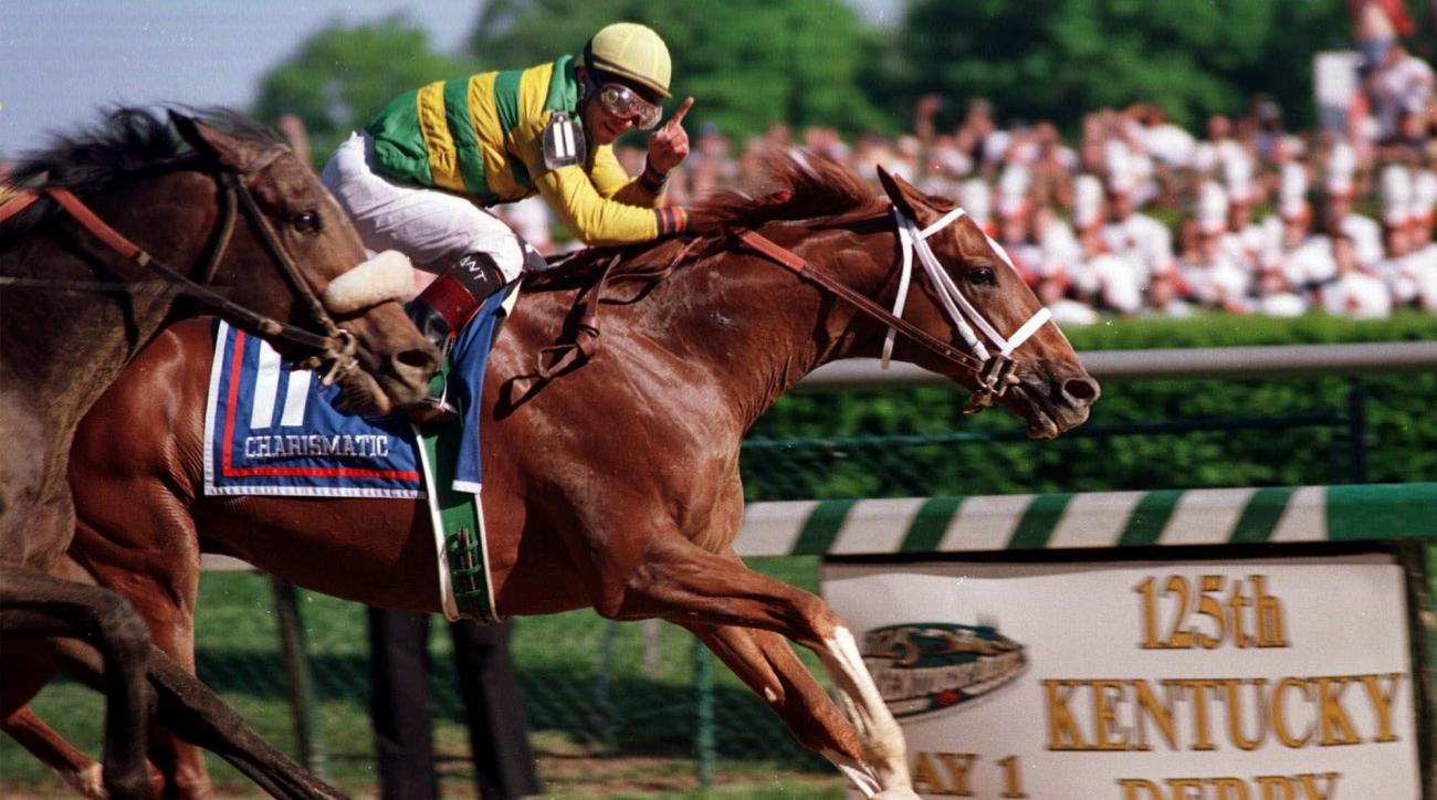 FILE - In this May, 1999, file photo, jockey Chris Antley, aboard Charismatic, signals his win as he crosses the finish line to capture the 125th running of the Kentucky Derby in Louisville, Ky. Antley, the late jockey who twice won the Kentucky Derby, wa