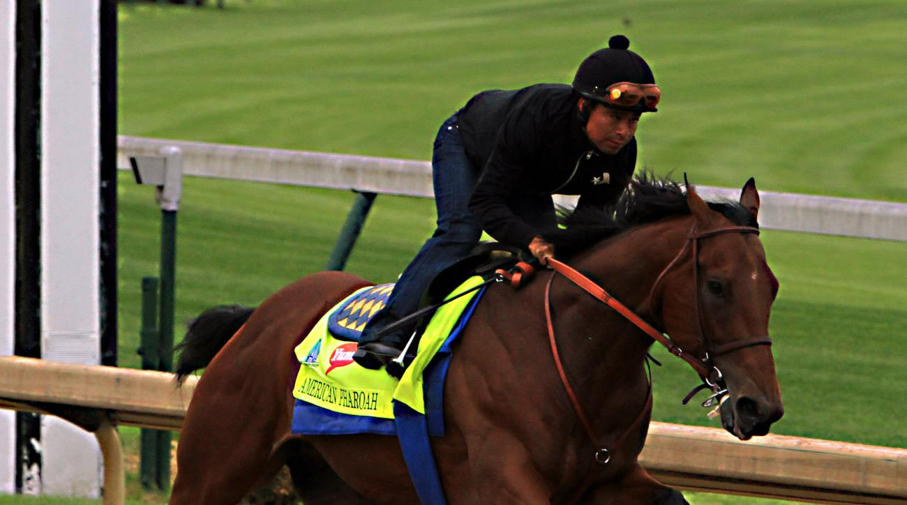 Martin Garcia rides Kentucky Derby hopeful American Pharoah during a morning workout at Churchill Downs in Louisville, Ky., Sunday, April 26, 2015. (AP Photo/Garry Jones)